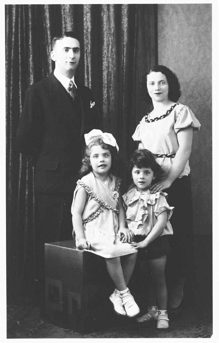 Prewar studio portrait of the Szajnfeld family.