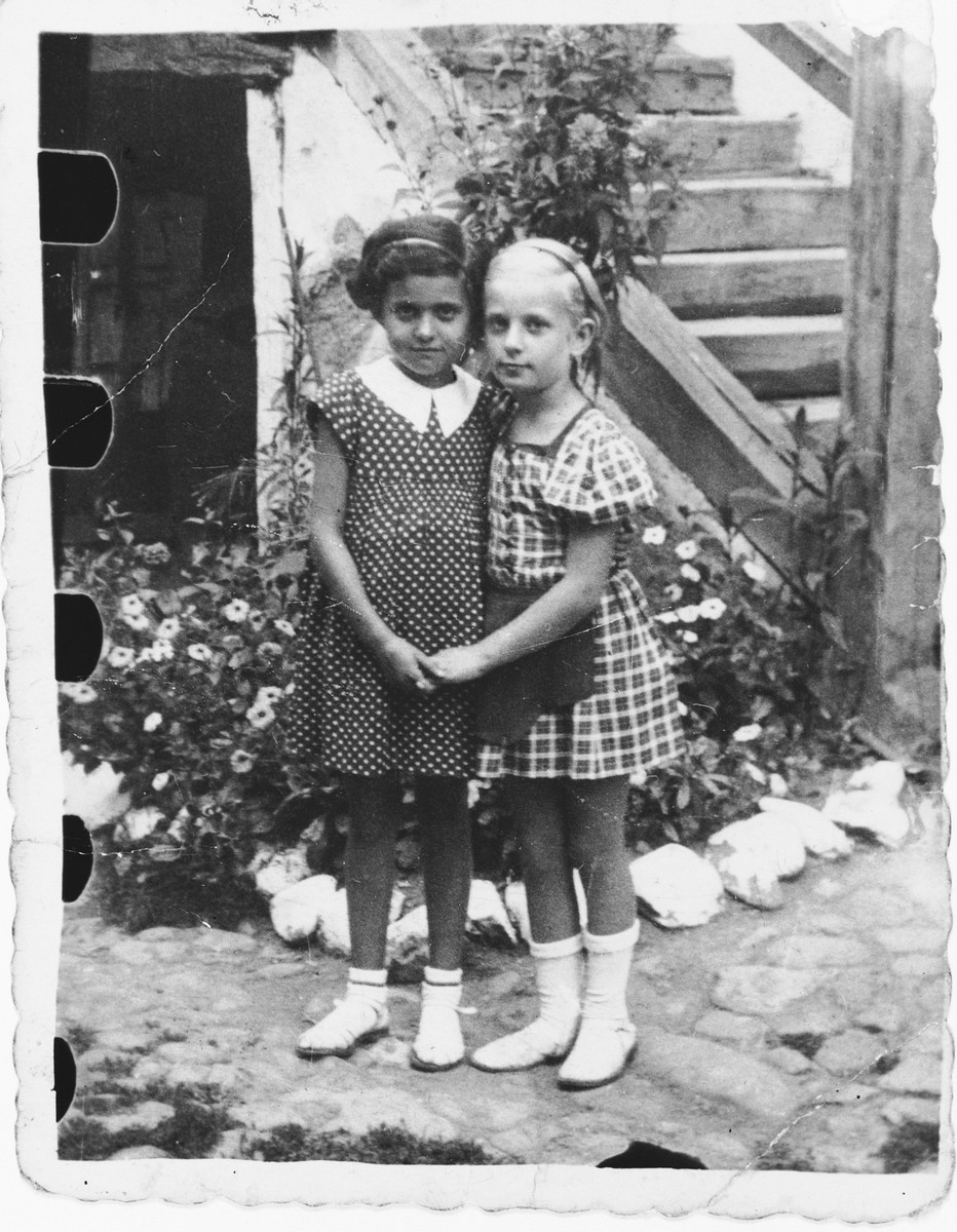 Two Jewish cousins pose outside in Bilki.  Pictured are Magdalena Mermelstein (left) and her cousin Kreola Roth.