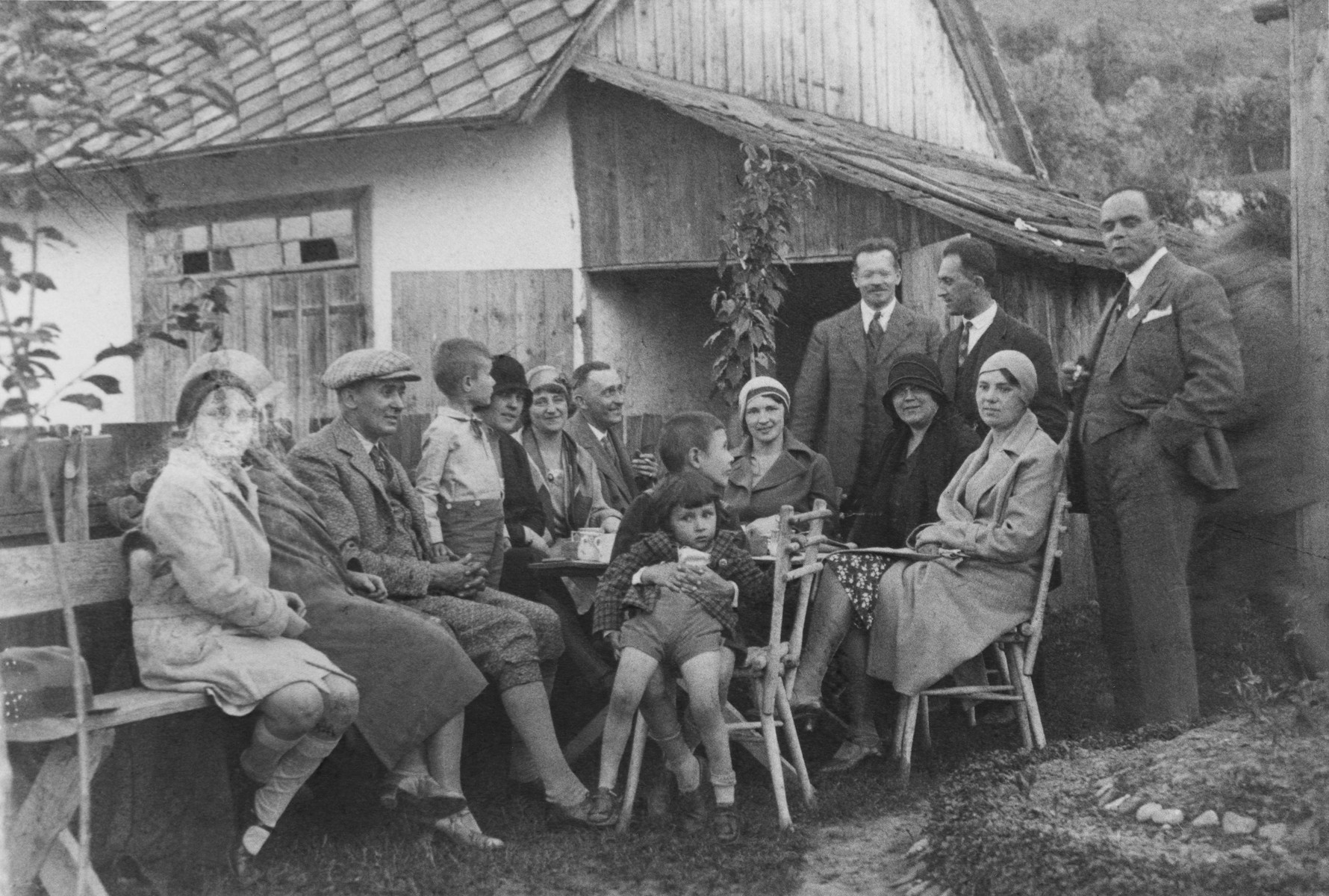 Lotte Gottfried (left) attends a social gathering at the home of the Offners, a Romanian family in Czernowitz.    She was escorted to the party by a family friend, Dr. Brilliant (standing third from the right).  Brilliant became a Nazi supporter after a trip to Berlin in 1938 and abruptly terminated his long standing friendship with the Gottfrieds.