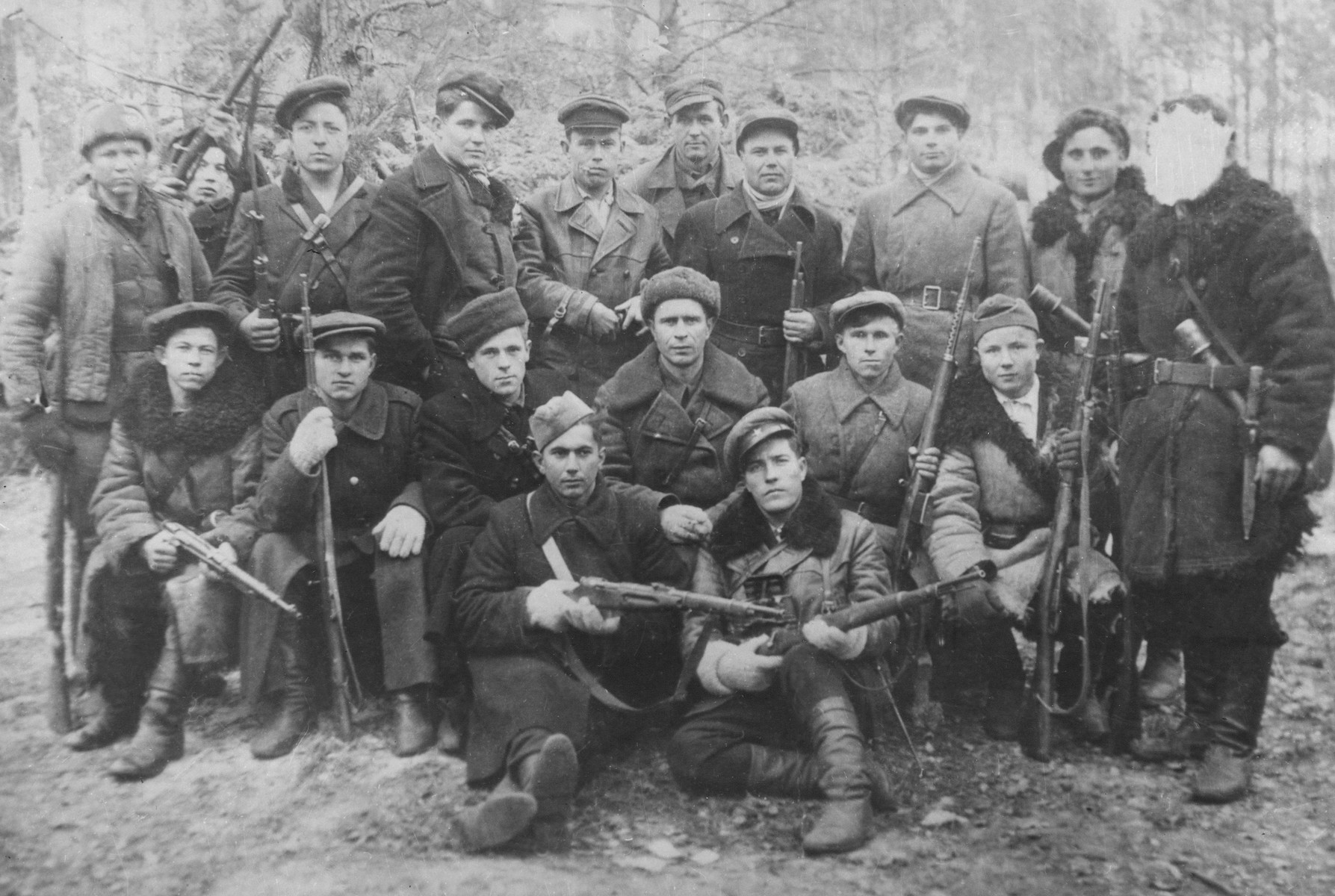 Group portrait of members of the intelligence unit of the Molotov partisan brigade.