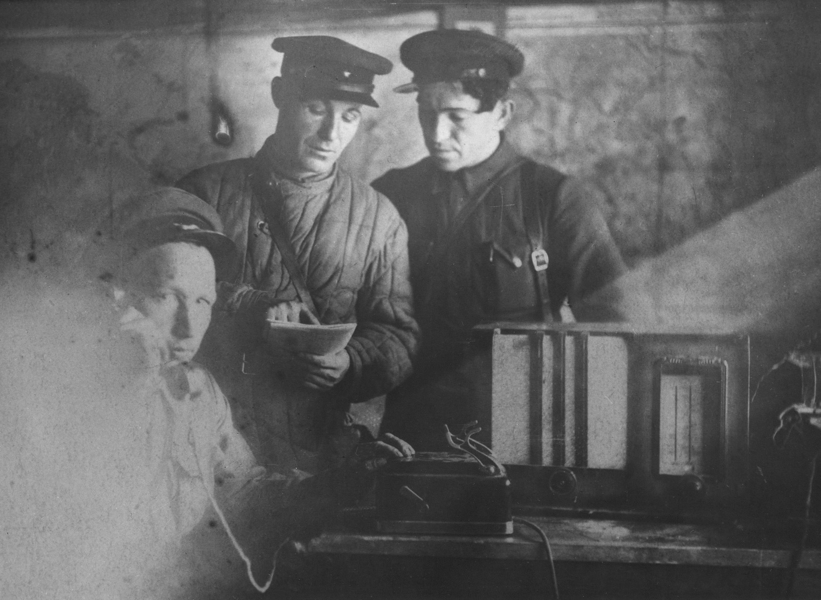 Vasiliy Nikitich Semyonov, chief of staff of the Shish detachment of the Molotov partisan brigade, makes a telephone call from a partisan bunker.