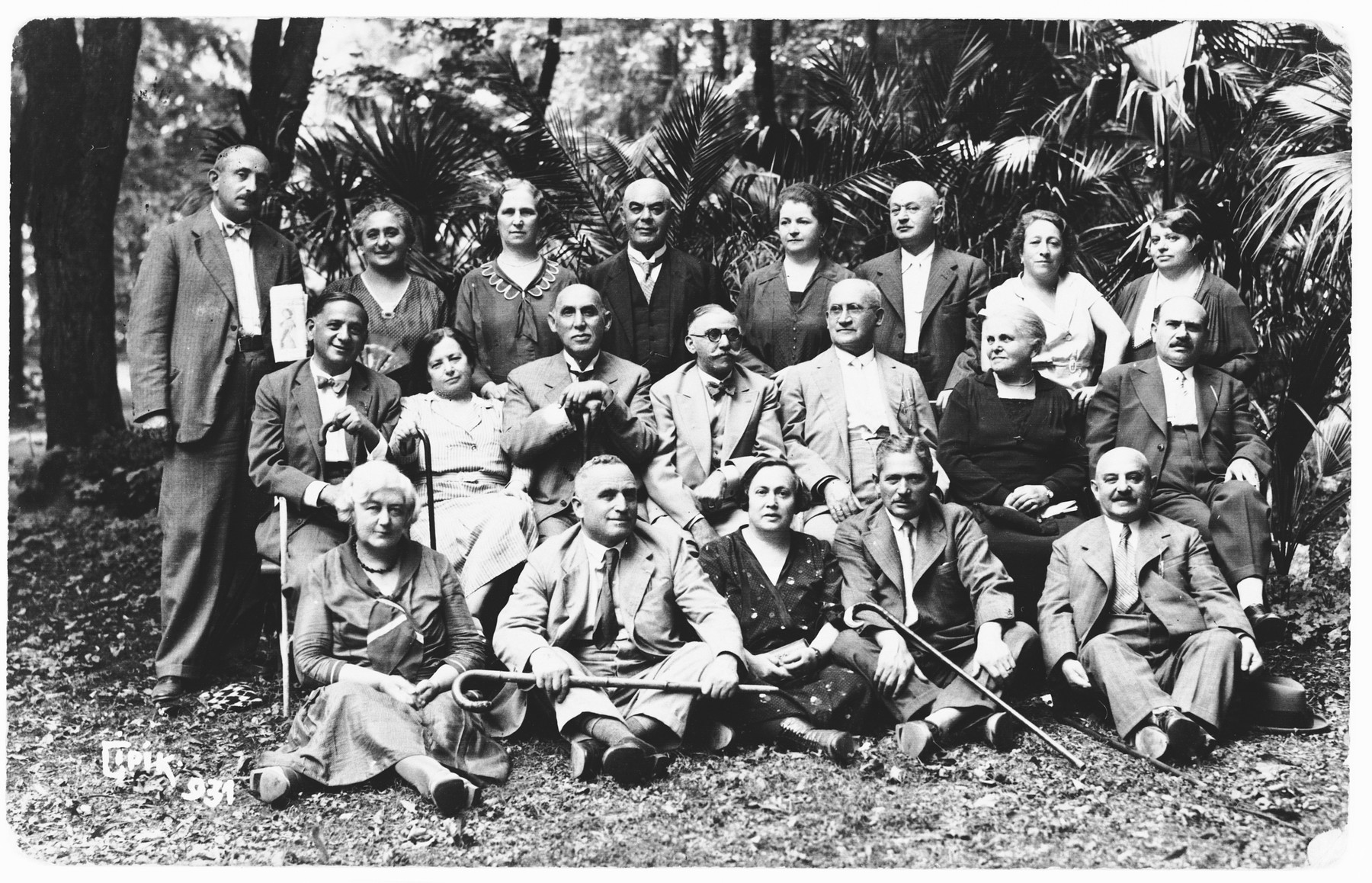 Group portrait of a Jewish social circle in Osijek, Croatia.  Among those pictured are Marko Spitzer's parents (front row), and Ilonka Krasso's father (top row, center).