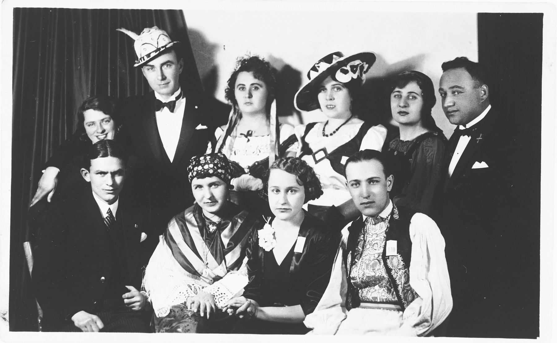 Group portrait of young Jewish men and women dressed in costumes in Osijek, Croatia.