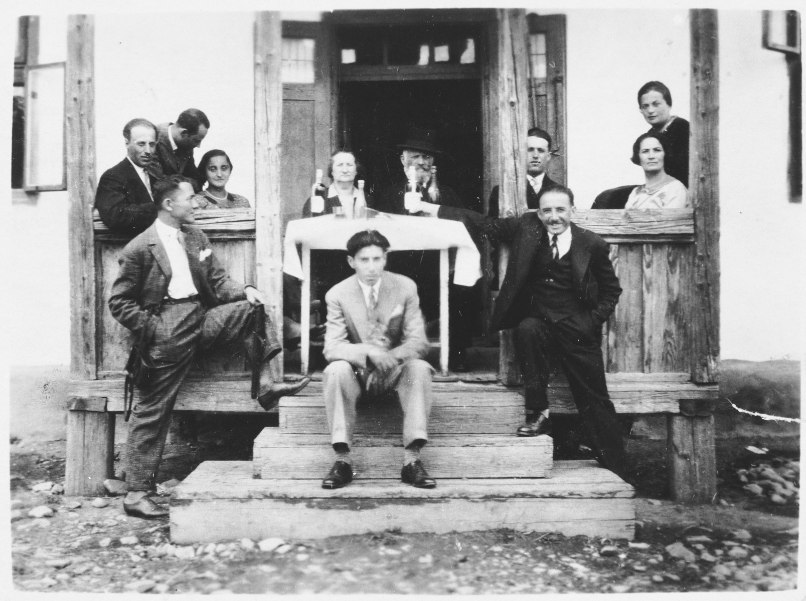 Members of the Katz family sit outside on the porch of their home in Cernauti, Romania.