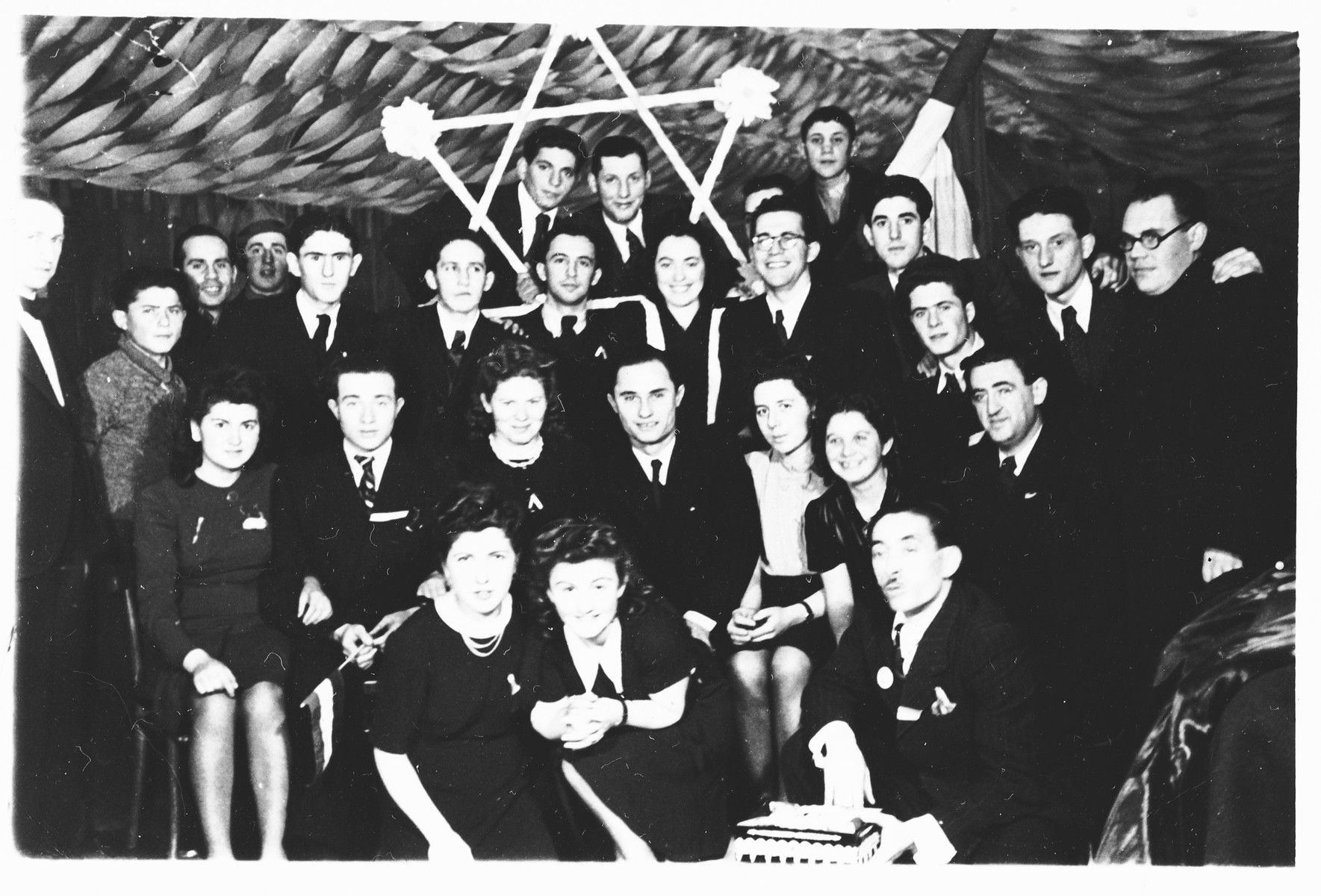 Members of Hashomer Hatzair Zionist youth in Mukachevo.  Symcha Weinberger is pictured third from the right in the middle row.  Also pictured are Izabella Jucowics Savarin (towards the bottom on the right side second row) and Imre Kolti (last person on the right).
