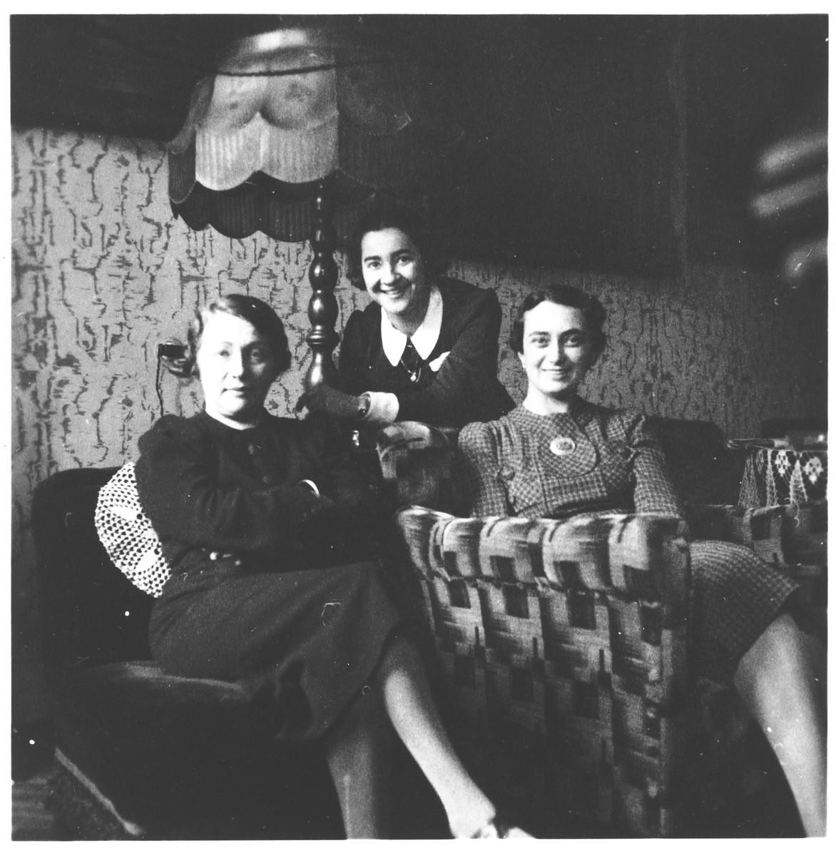 Three Jewish women seated in a living room in Osijek, Croatia.  Among those pictured is Ilonka Spitzer (right).