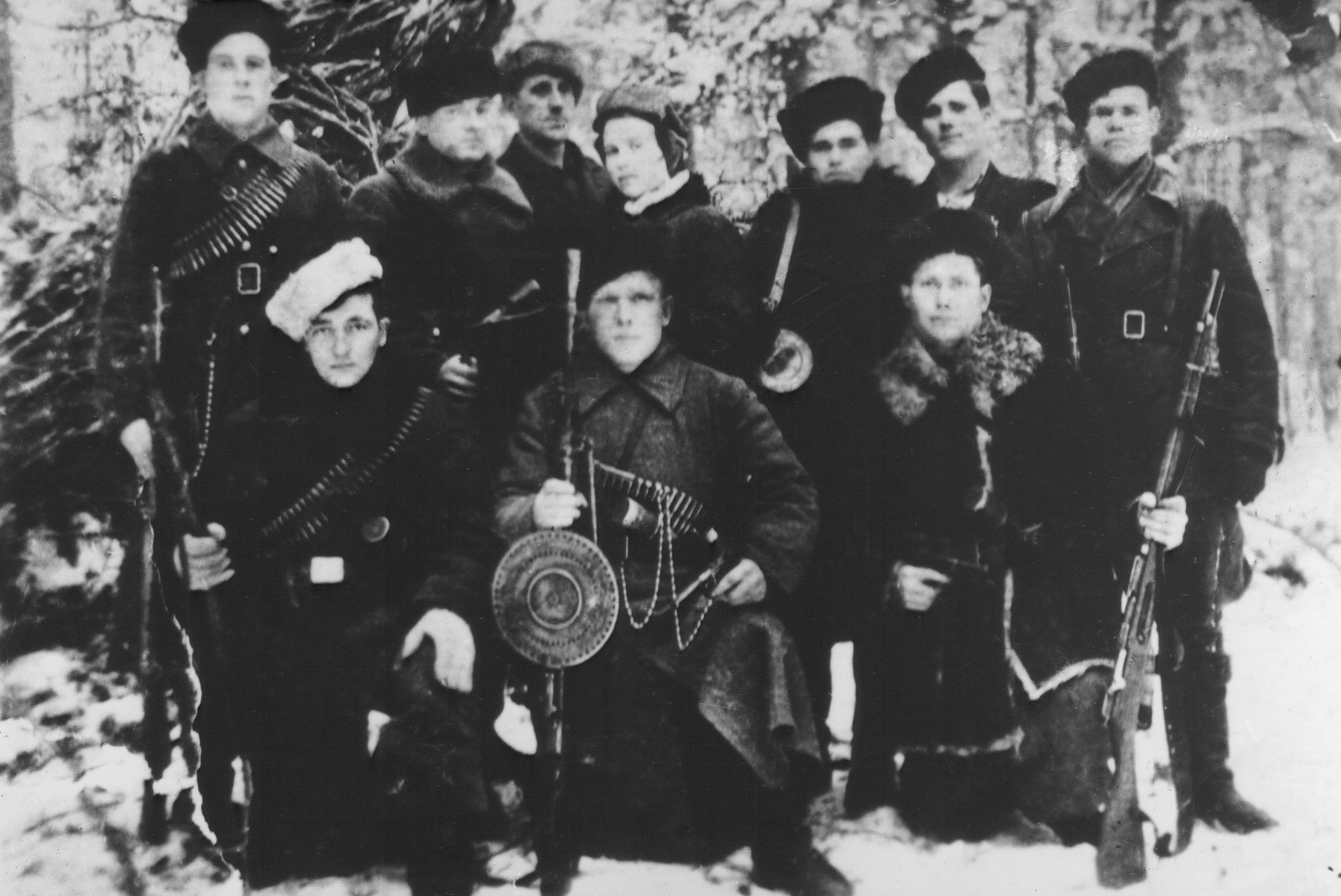 Group portrait of Soviet partisans who are members of the Shish detachment of the Molotov partisan brigade.