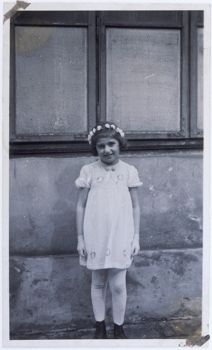 Portrait of six-year-old Branka Juhn, a Jewish child hiding as a Catholic in wartime Vienna, after receiving her First Communion at a church in the Sixth District.