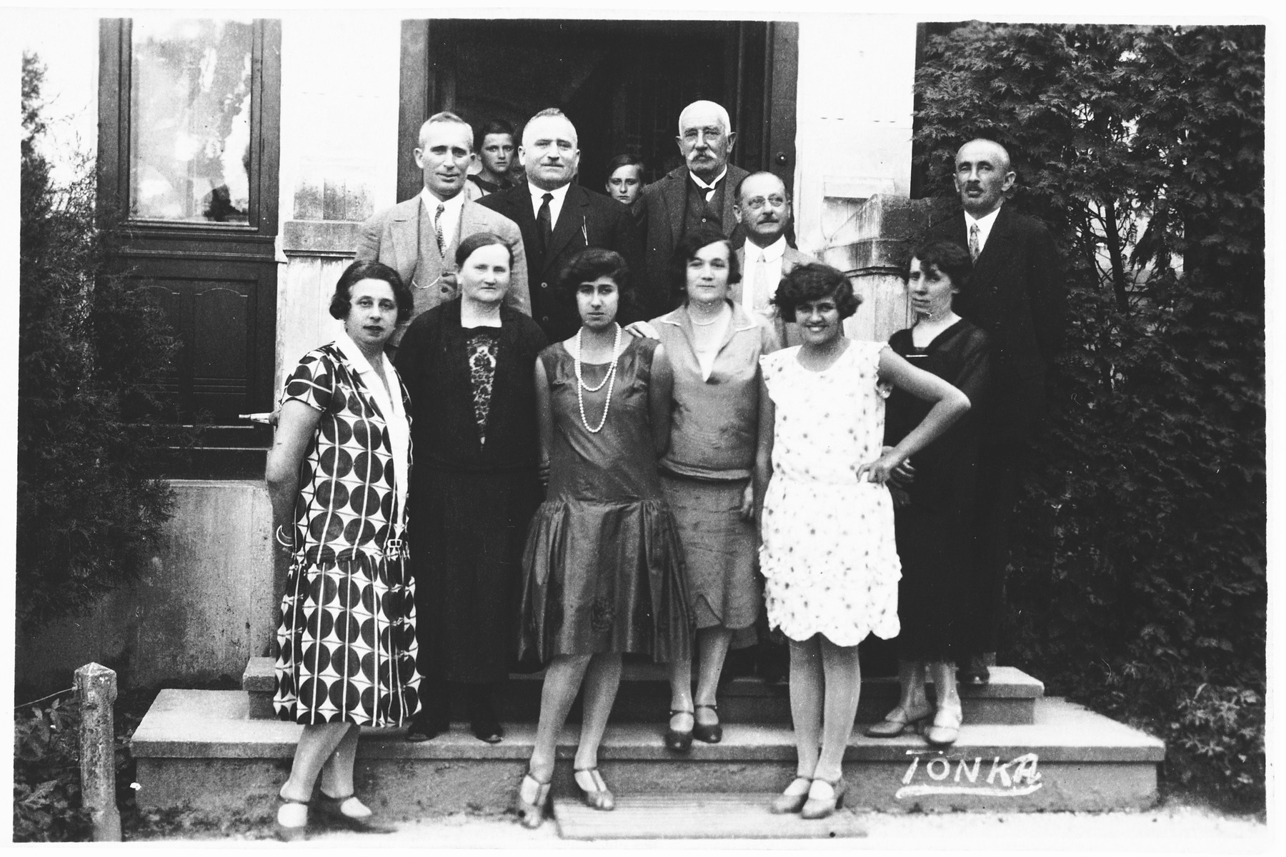 Members of the Spitzer family pose on the steps of a house in Osijek, Croatia.