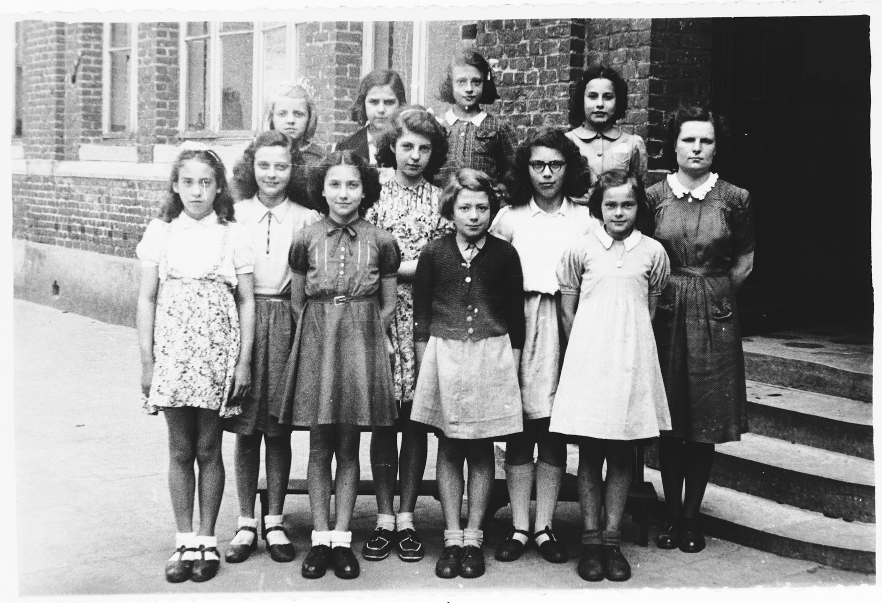 Ida Szajnfeld poses with other schoolmates in a Catholic school after the war.