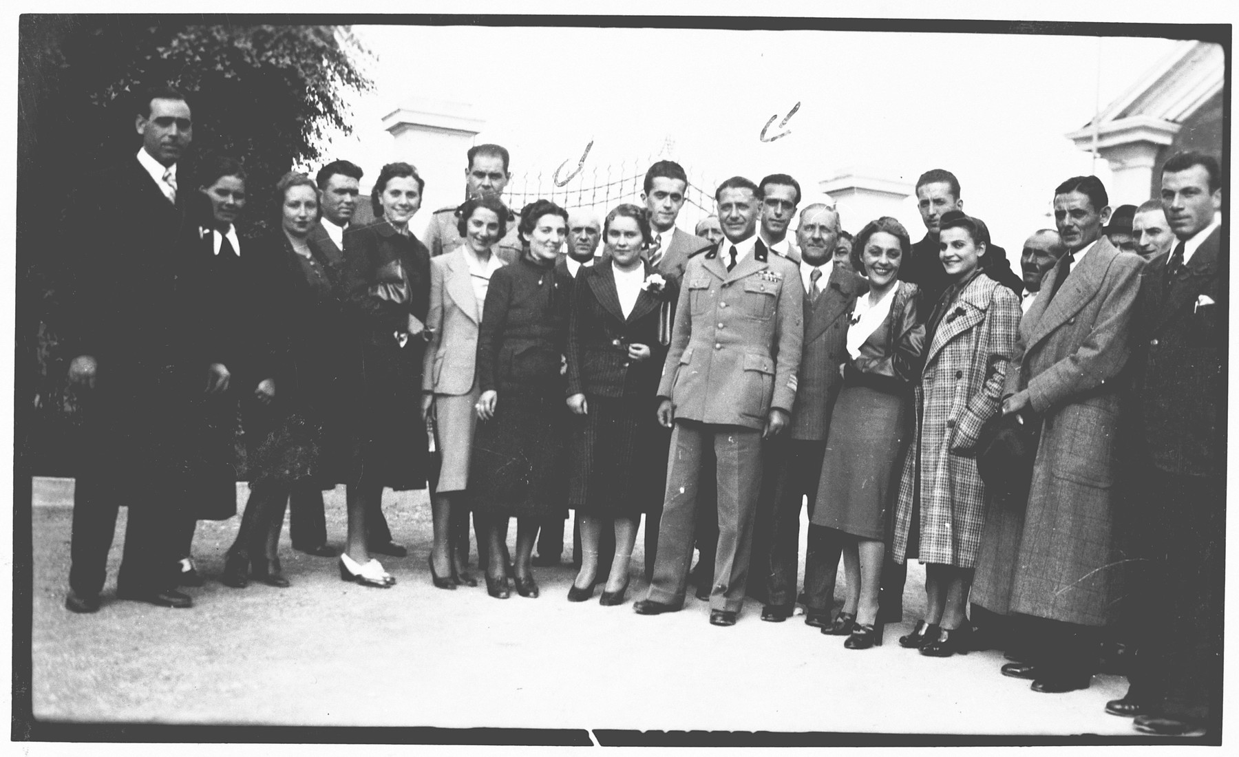 """Aldo Foa poses with his co-workers from the army laboratory while on an office trip.  The workers presented this photograph to Aldo Foa as a going-away momento after Foa was fired from his post as a result of the discriminatory laws of 1938.  The inscription on the back of the photograph reads, """"In memory of the beautiful trip; the workers of the separated Noceto's department give this album to their director Colonel Cavalier Aldo Foa who promoted it and made it possible."""""""