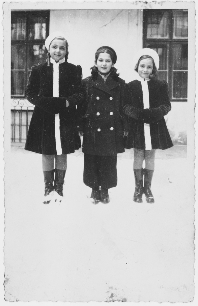 Three young girls pose outside in the snow.  Pictured from left to right are: Miriam Spitzer, Suzy Nadj and Leah Spitzer.  Suzy's mother was murdered shortly after the German invasion of Yugoslavia.  Following her death, Suzy and her brother Egon tried to flee to Hungary.  They were shot and killed at the border.