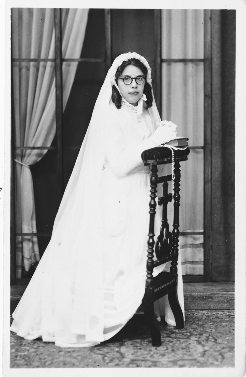 Ida Szajnfeld takes first communion while hiding in a Catholic orphanage.