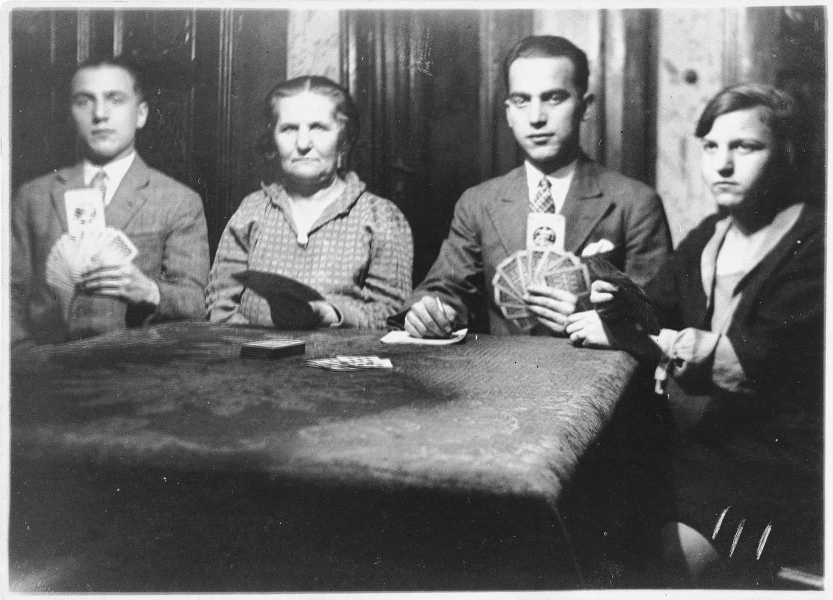 The Lewitzky family gathers for a family card game.  Sigmund Lewitzky is seated second from the right.