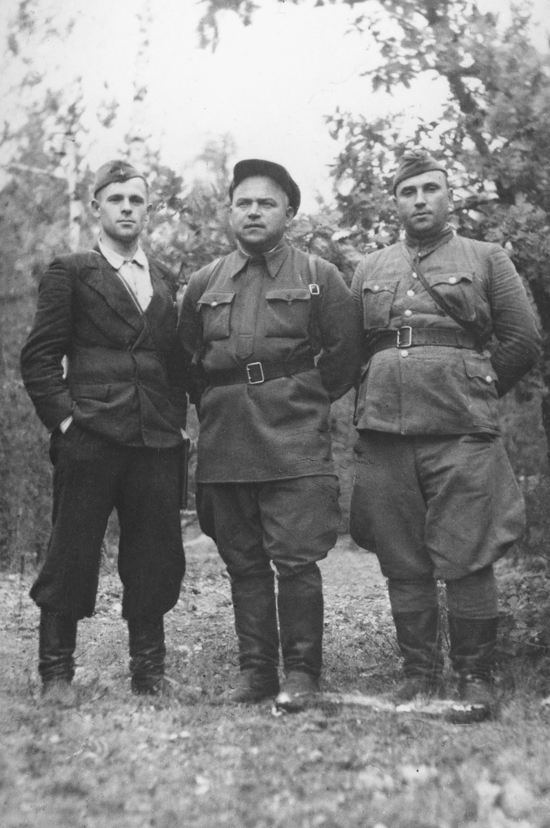 Three Soviet partisan leaders pose outside in the forest.  Pictured from left to right are: M. I. Gerasimov, commander of the Molotov brigade, Pinsk region; S. I. Sikorskiy, secretary of the underground regional committee of the Communist Party of the Brest region; N. V. Bobkov, commander of the Soviet Belarus partisan detachment, Brest region.