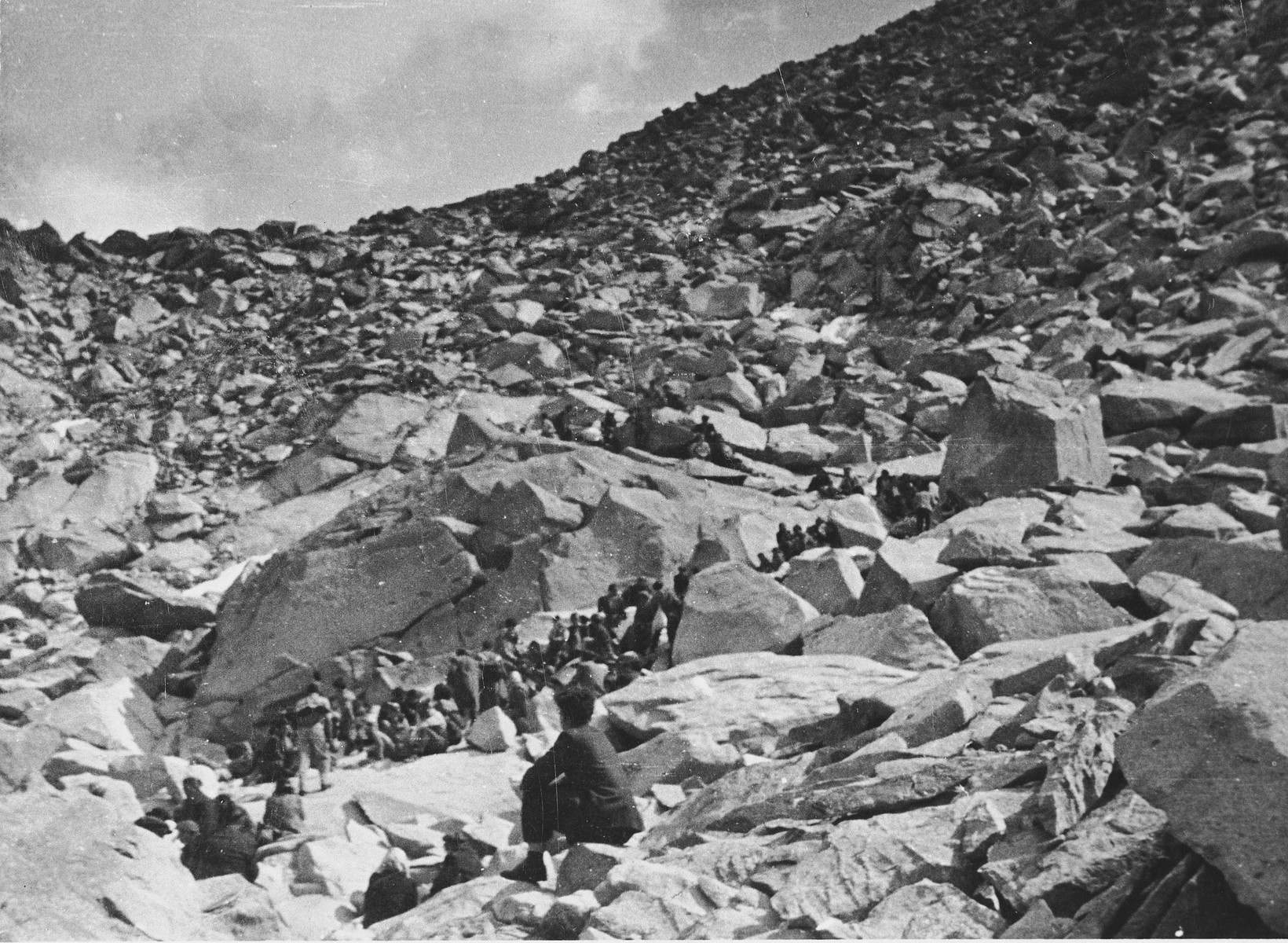A Bricha guide escorts a column of Jewish displaced persons over the Alps into Italy.