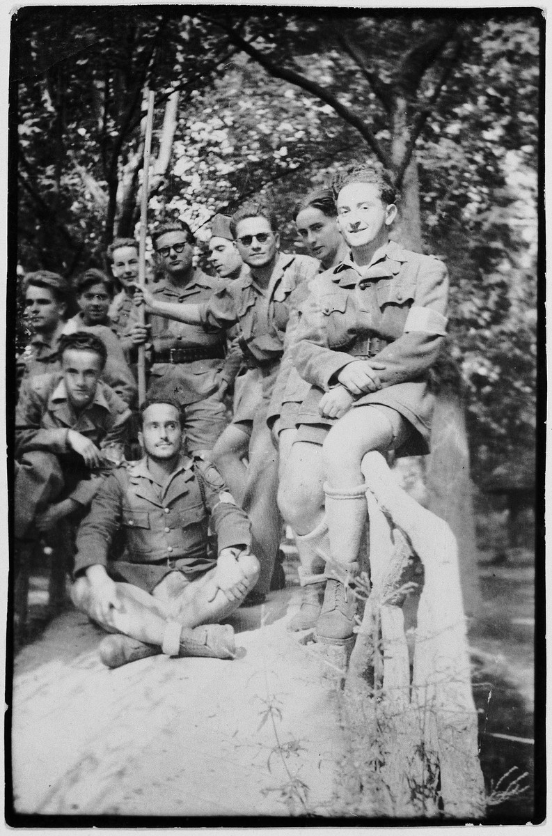 Group of Maquis rest outside after having captured the city of Romans.  Eryk Goldfarb is pictured on the right.