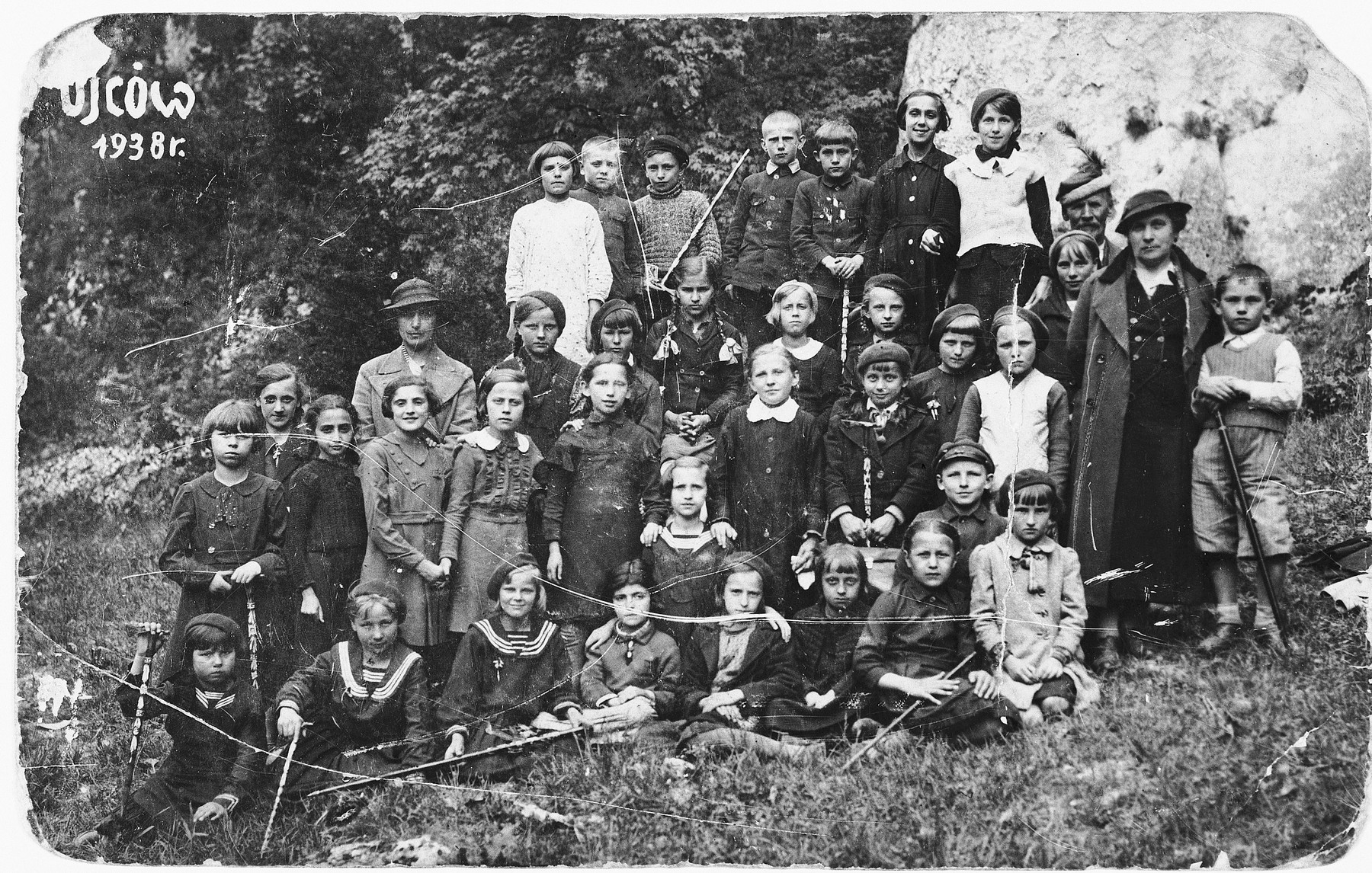 School children from Olkusz go on a class trip to Ojcow.  Among those pictured is Hela Kolin, standing fourth from the left in the second row.  There were three other Jewish girls in the class.