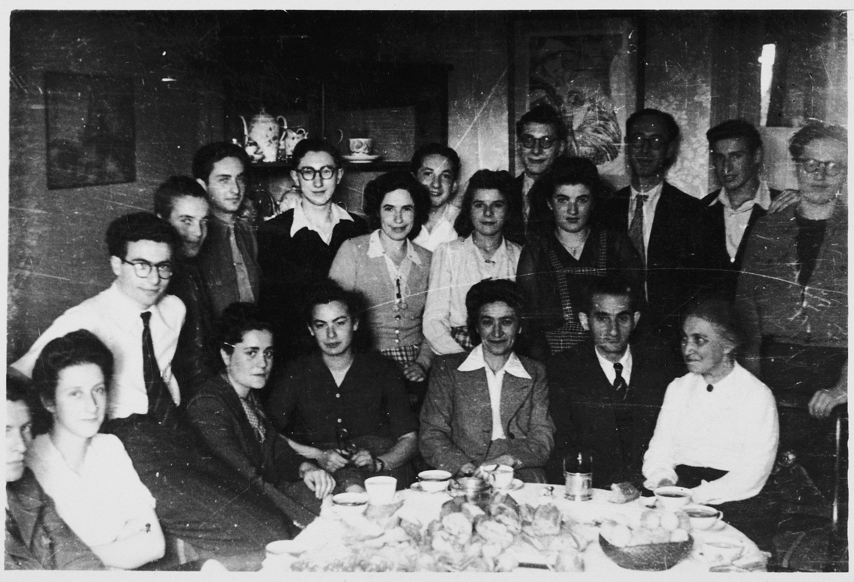 OSE staff and former students attend a party in Paris to celebrate Mr. Koenig's safe return from concentration camp.  Mr. Koenig had been the leather-making instructor in OSE's Chabannes children's home.  Among those pictured are Lida Jablonsky, Fee Beyth, Mrs. Koenig, Mr. Koenig, Mrs. Reich and Wolf Blumenreich (who also returned from concentration camp.)