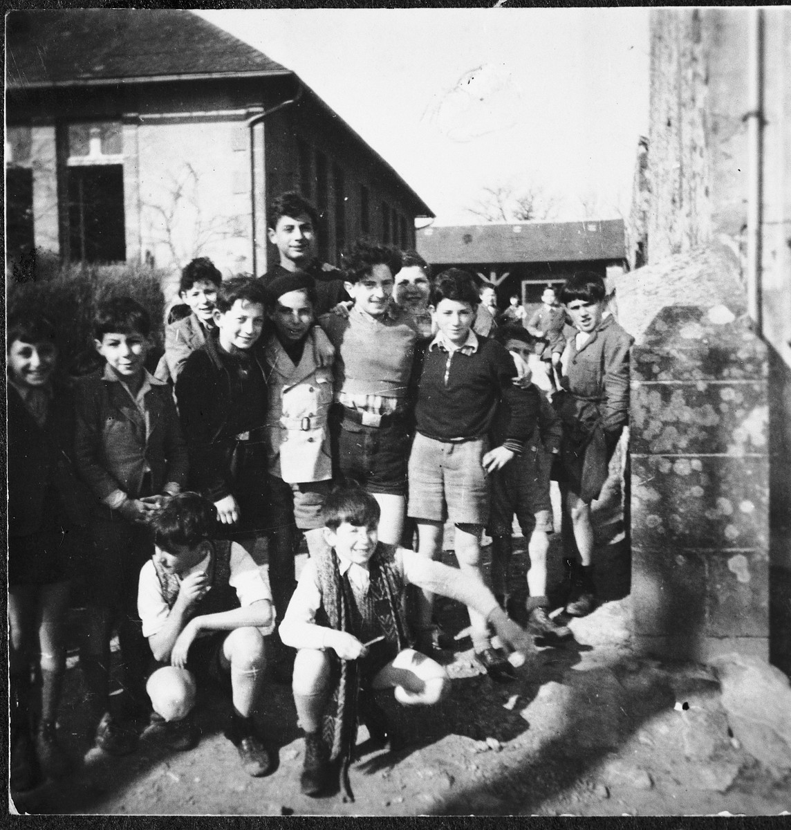 Jewish children pose on the steps outside the Chabannes children's home.