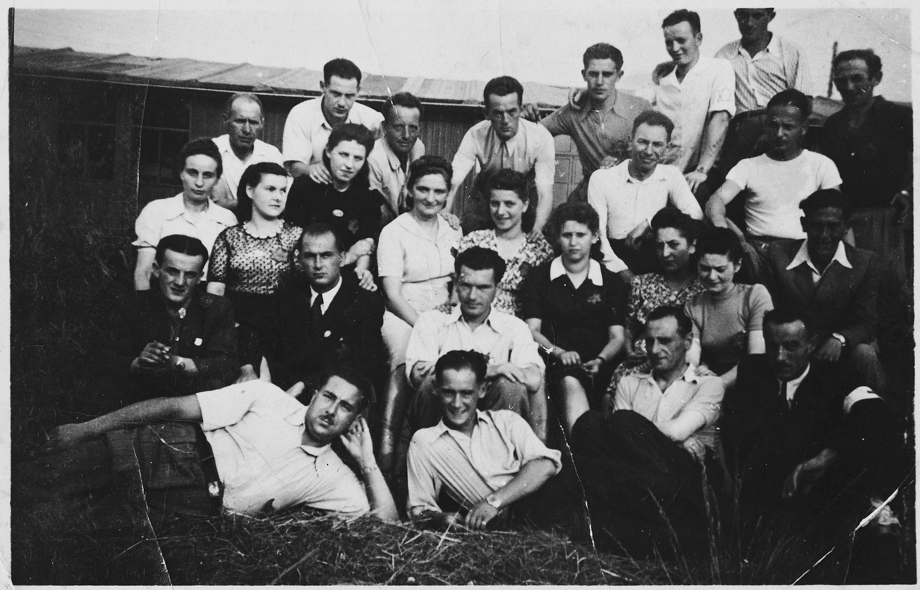 Prisoners in the Markstadt labor camp.  Among those pictured is Dr. Wolf Laitner, seated center, in the white shirt, directly behind the man leaning on his elbow.   Also pictured is Ruth Lieber (later Rydelnik) (second row from the top, third from the left).