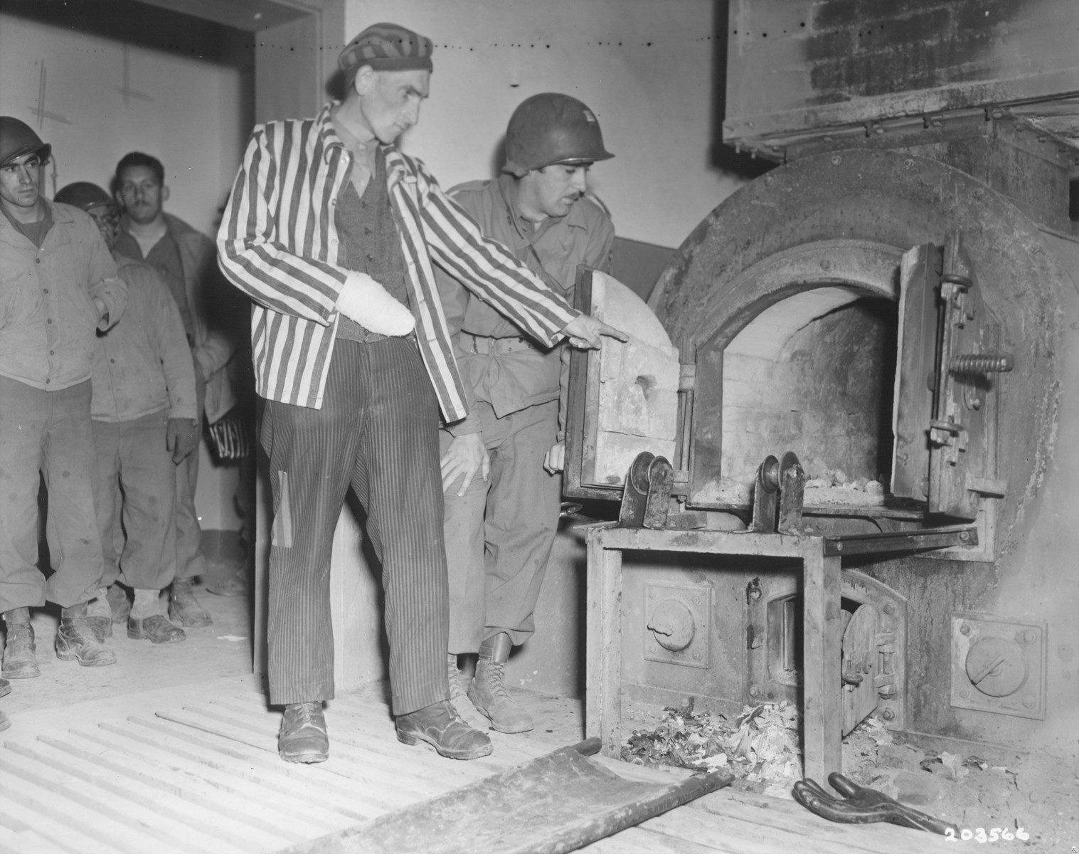 A Polish survivor shows John L. Lyndon the Nordhausen crematoria.