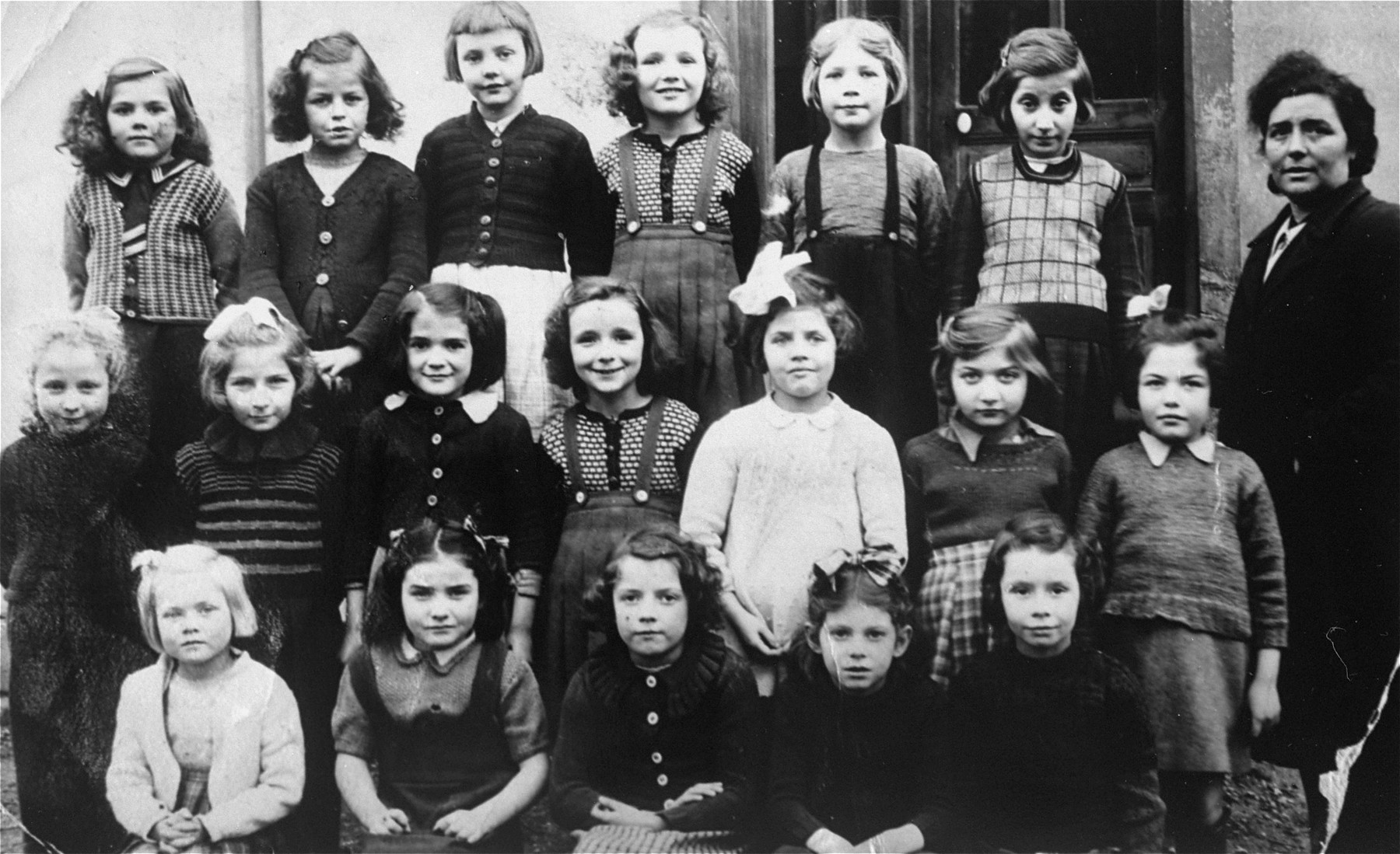 Group photograph taken at the school at an orphanage for Jewish children in Verneuil.   Among these children is Evi Weisz.