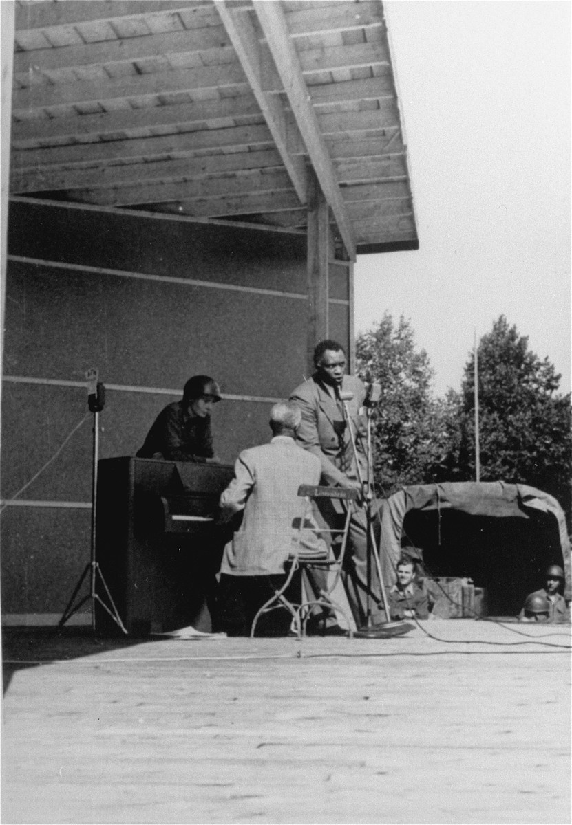 Entertainer Paul Robeson performs for American soldiers in Dachau.