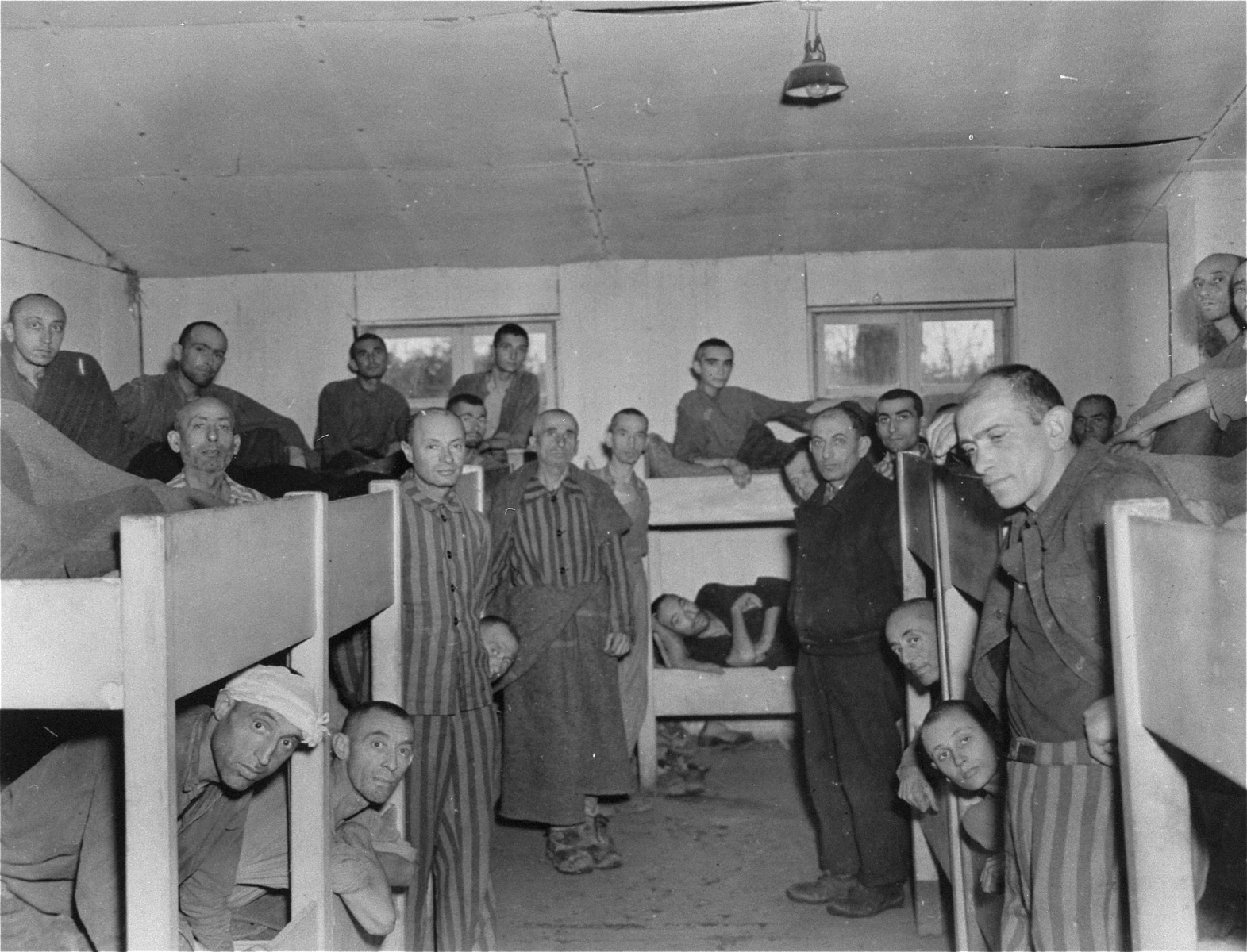 Survivors in a barracks in the Ampfing concentration camp several days after liberation.