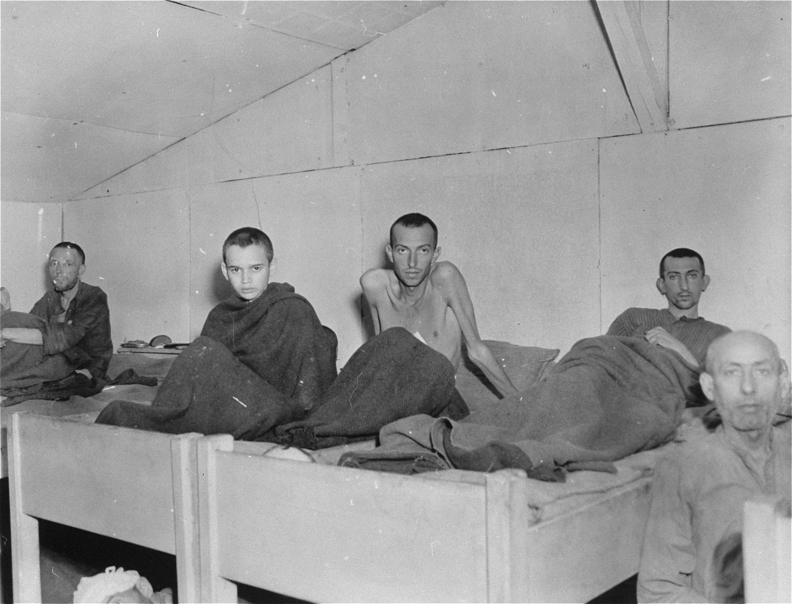 Survivors in the camp infirmary after being liberated by the 14th Armored Division.