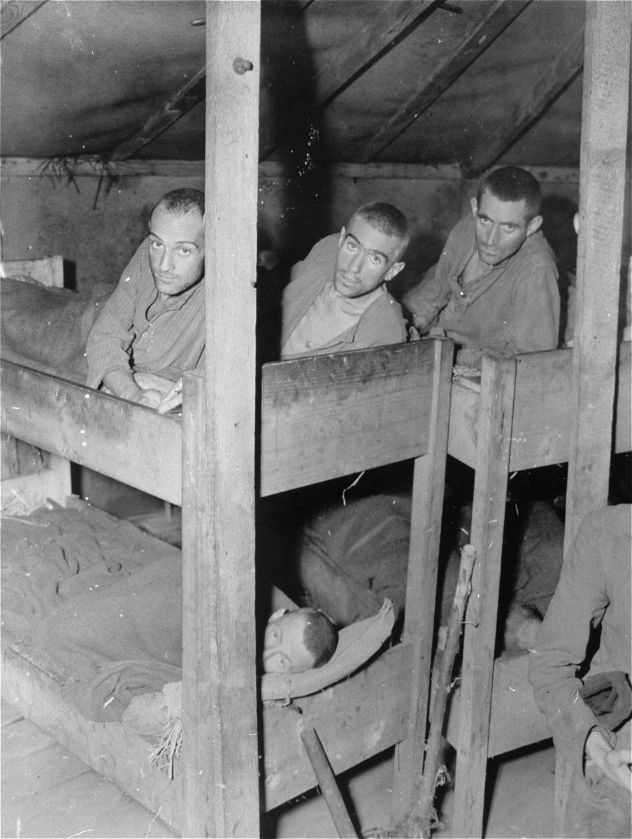 Survivors in a barracks in the Ampfing concentration camp.