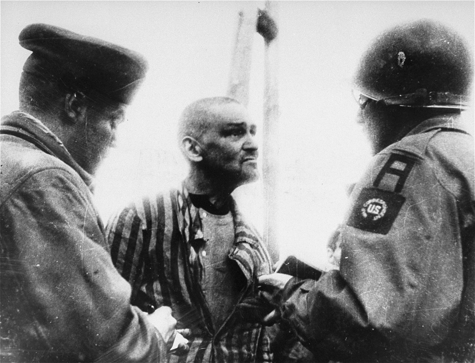 Dmitiri Sobolew, a Russian orthodox priest from Paris, eagerly gives information to two U.S. war correspondents, Chris Cunningham of United Press and W.C. Heinz of the New York Sun.    Sobolew was arrested and many times beaten for aiding Jews.