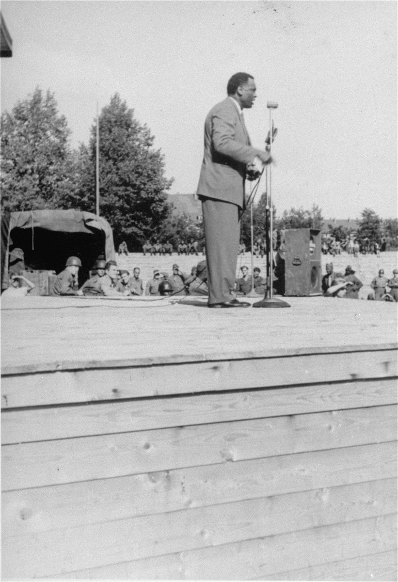 Entertainer Paul Robeson performs for the American soldiers in Dachau.