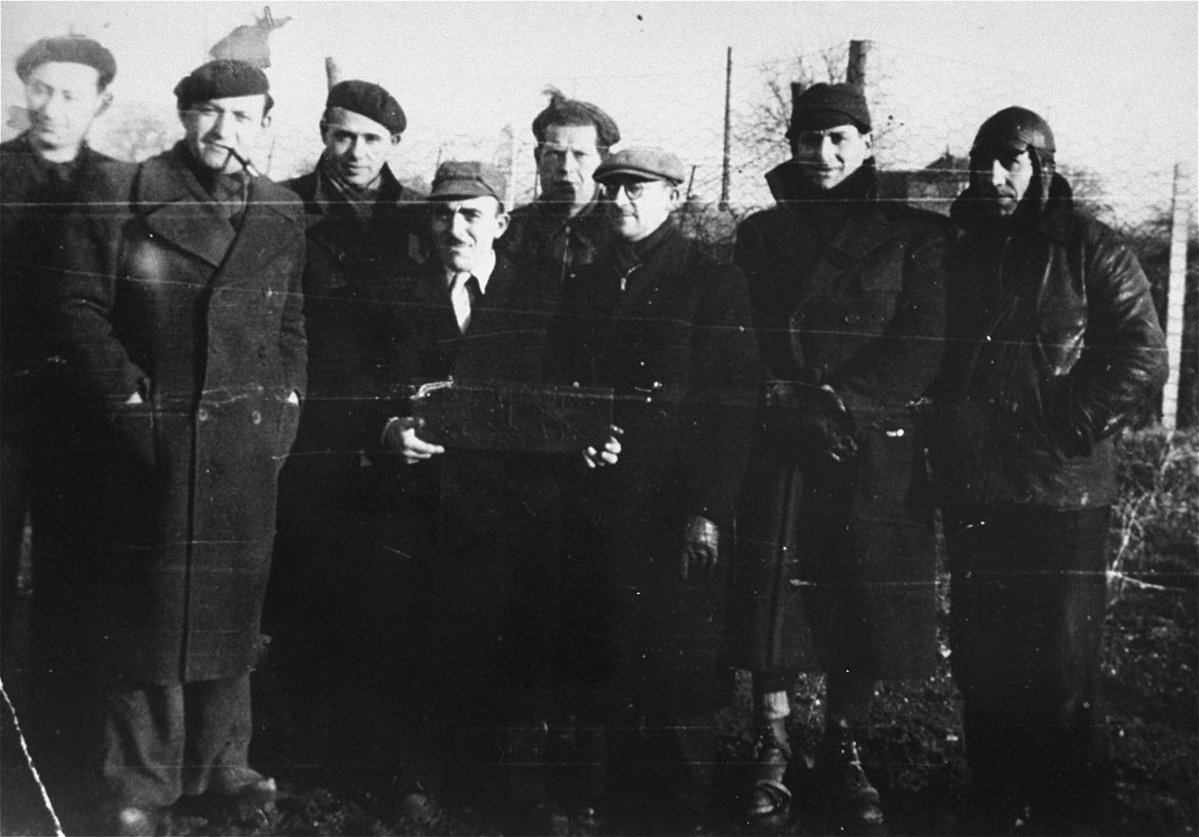 A group of prisoners pose in the Beaune-la-Rolande transit camp.    At the far right is Bernard Tepicht who was deported to Auschwitz, where he perished in 1942.  His wife was transported to Auschwitz via Drancy in June of 1942 and also perished.  Their two daughters, Lea (now Lea Borenstein), born in 1929, and Georgette (now Georgette Brinberg), born in 1938, survived the war by hiding on the run, either by themselves or on farms.