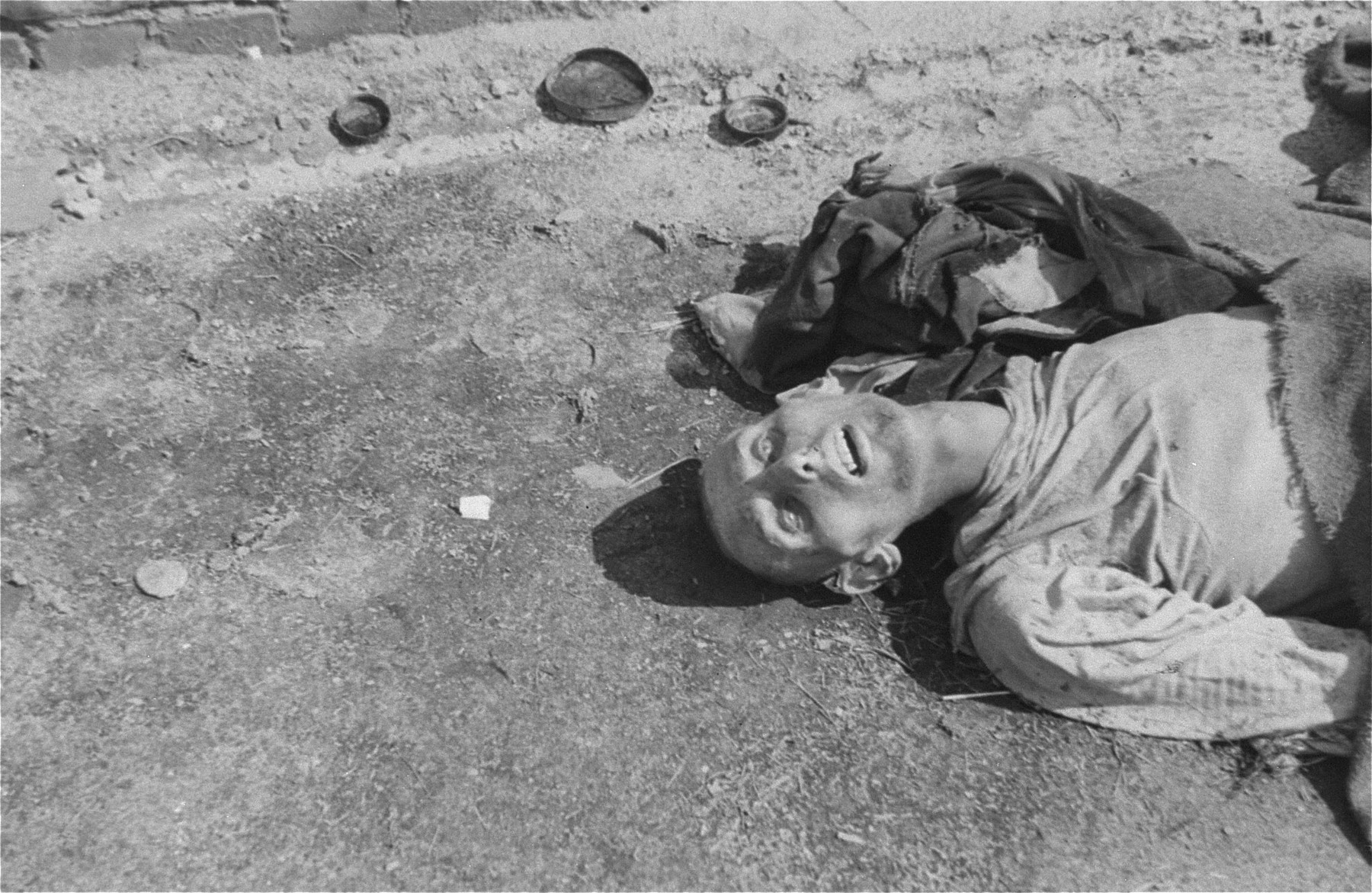 The corpse of a man in Woebbelin who died of starvation prior to the liberation of the camp by U.S. troops.