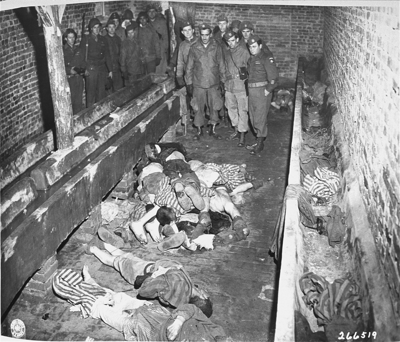 American troops look at prisoners' bodies found in a latrine in the Woebbelin concentration camp.