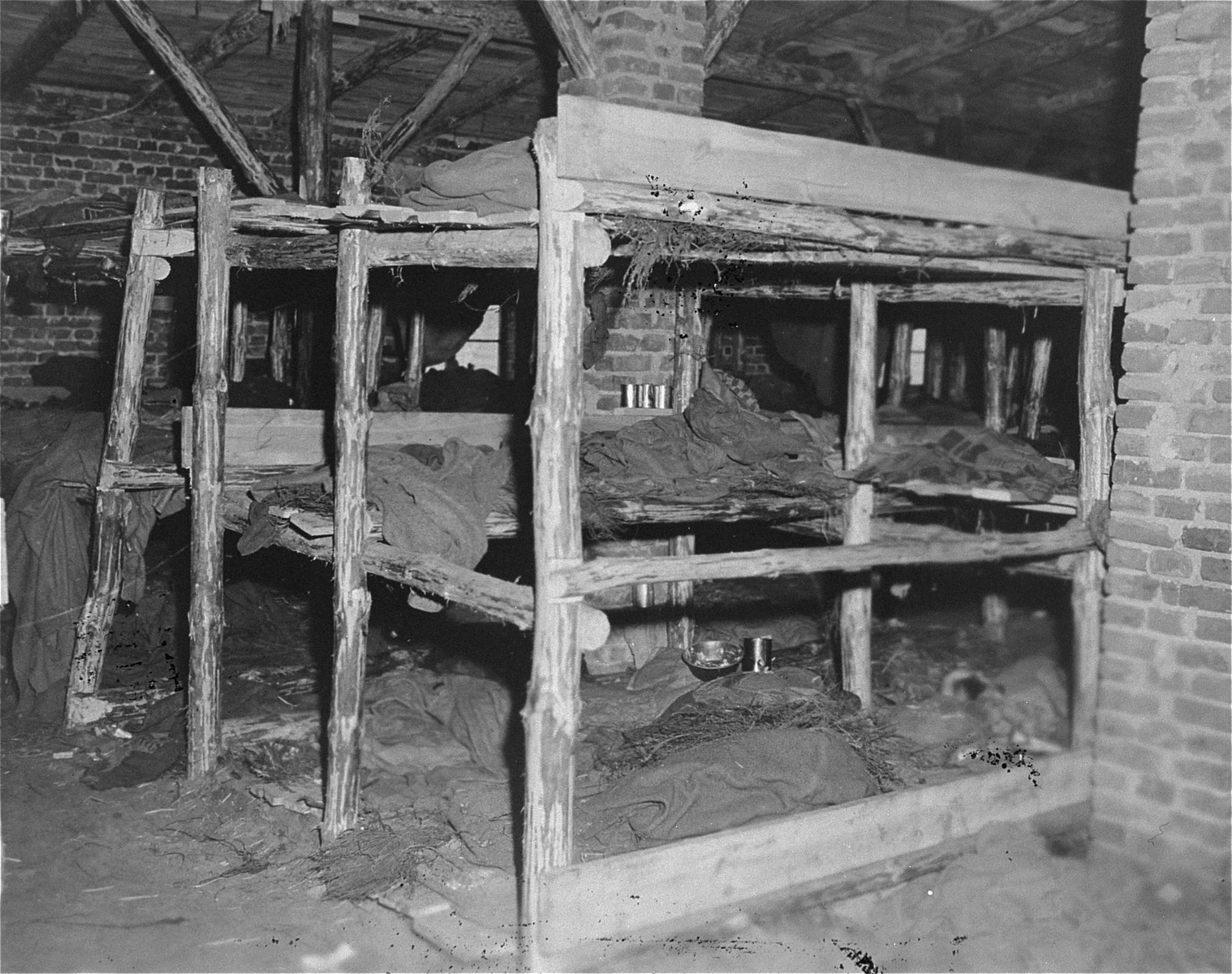 View of prisoners' bunks in a barracks in the Woebbelin concentration camp.