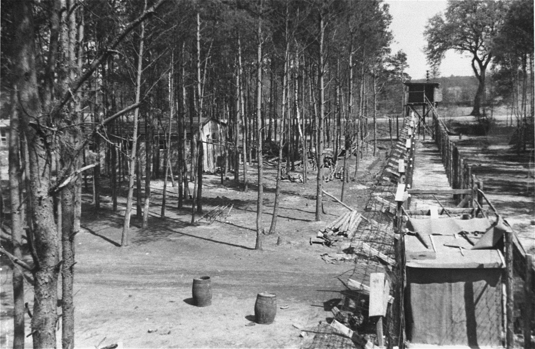 The fenced perimeter and an entrance to the women's camp at Woebbelin.