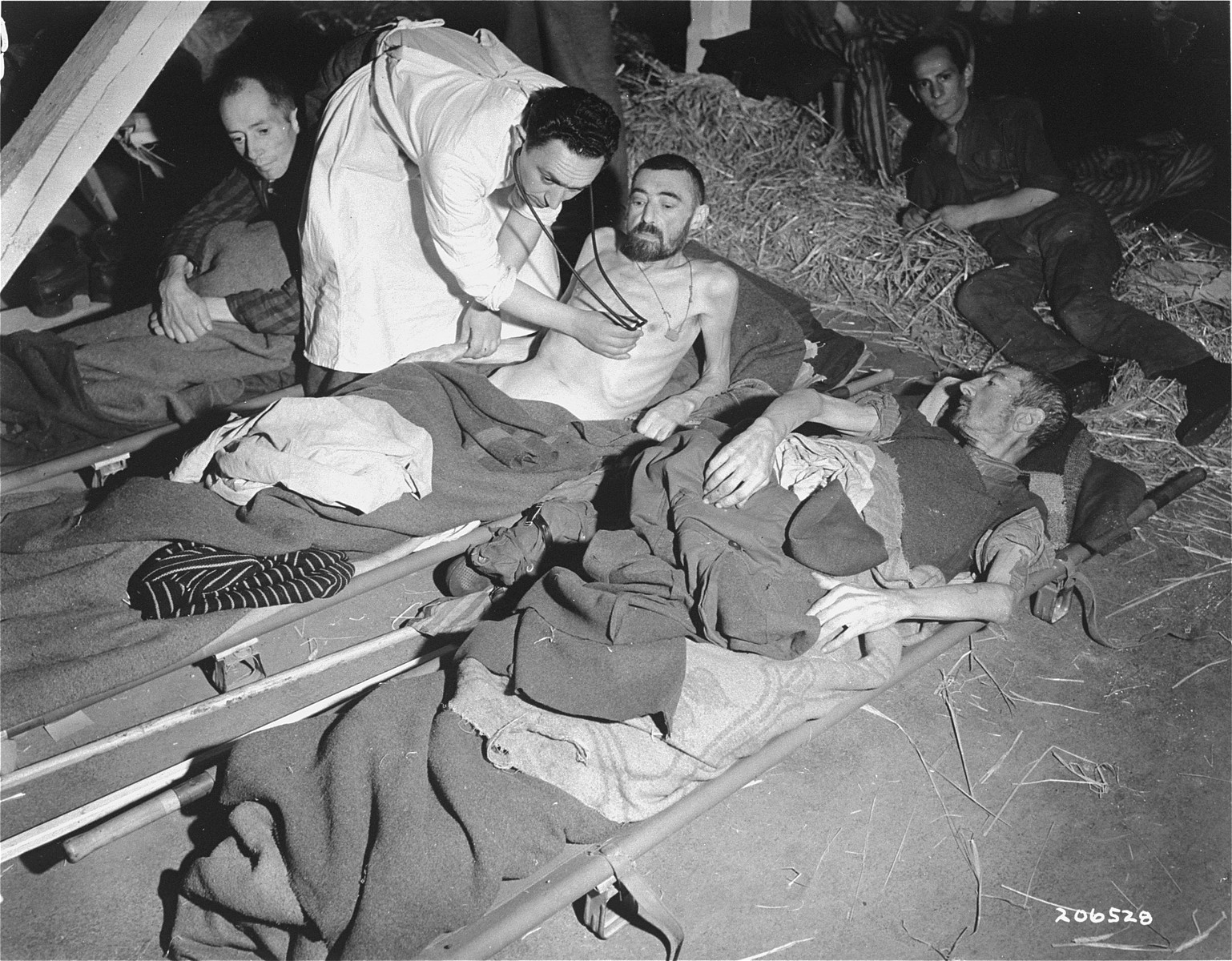French survivors from Woebbelin are examined by a Polish doctor after liberation.
