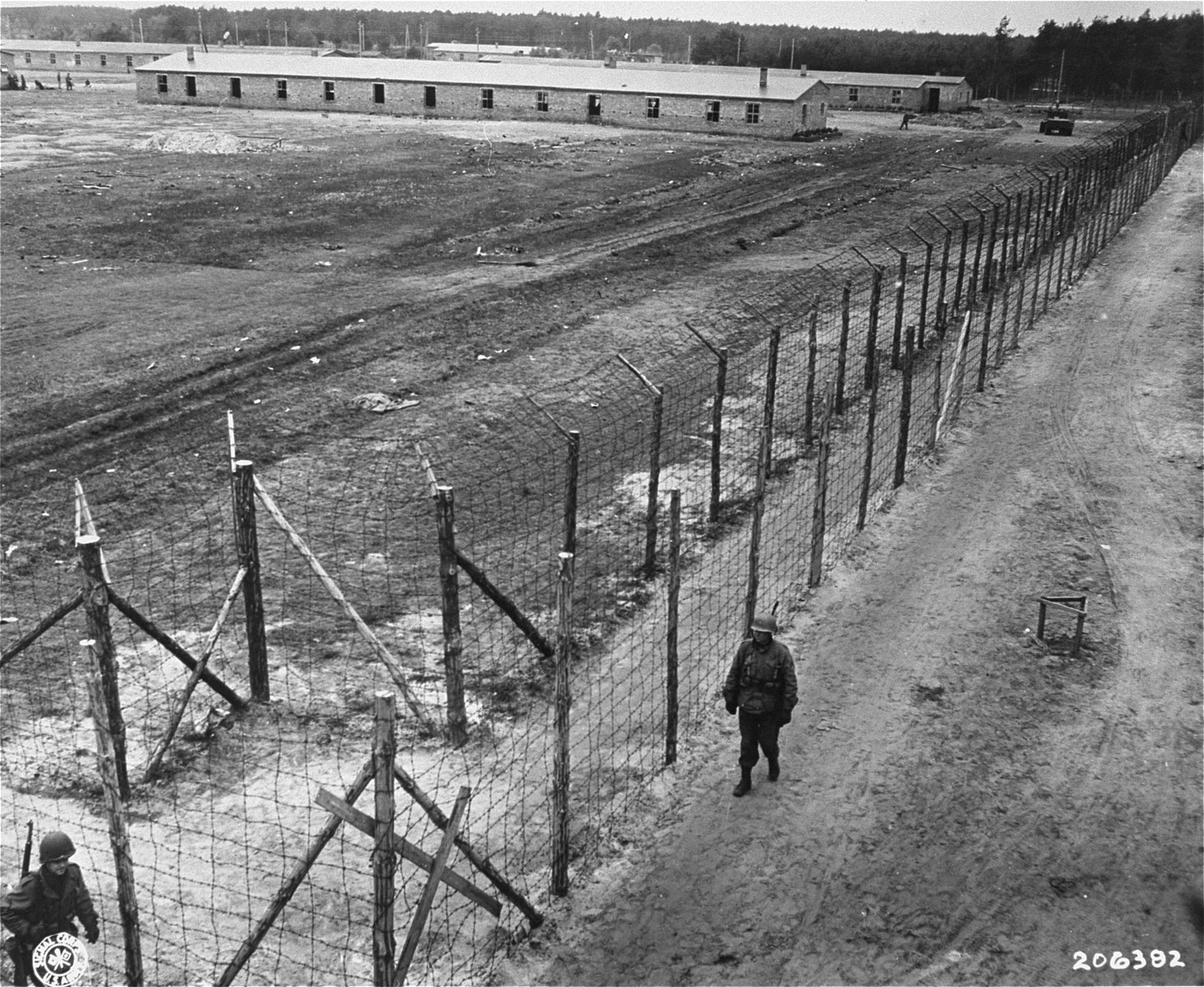 American soldiers patrol the perimeter of the newly liberated Woebbelin concentration camp.