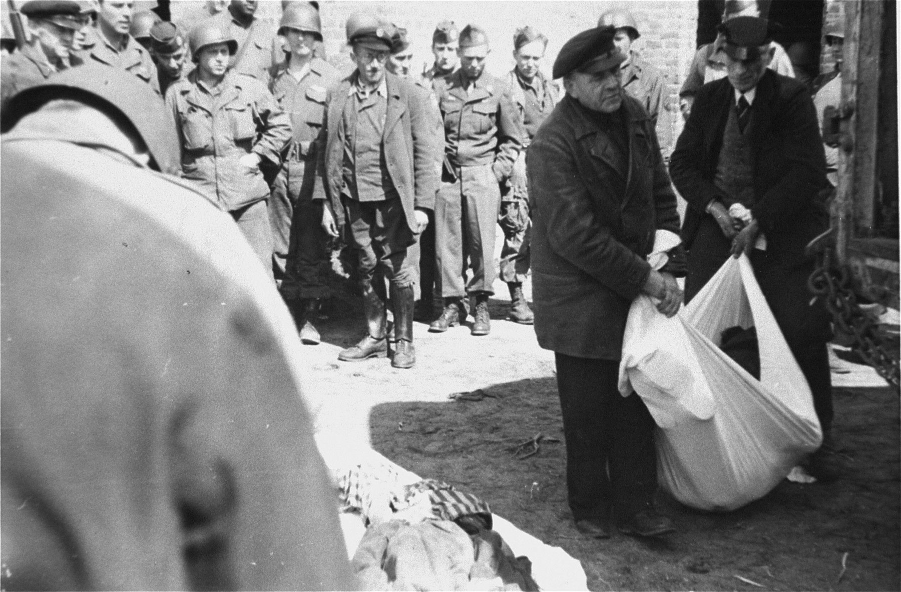 German civilians from the nearby town of Ludwigslust are made to clear corpses from barracks of the Woebbelin concentration camp.