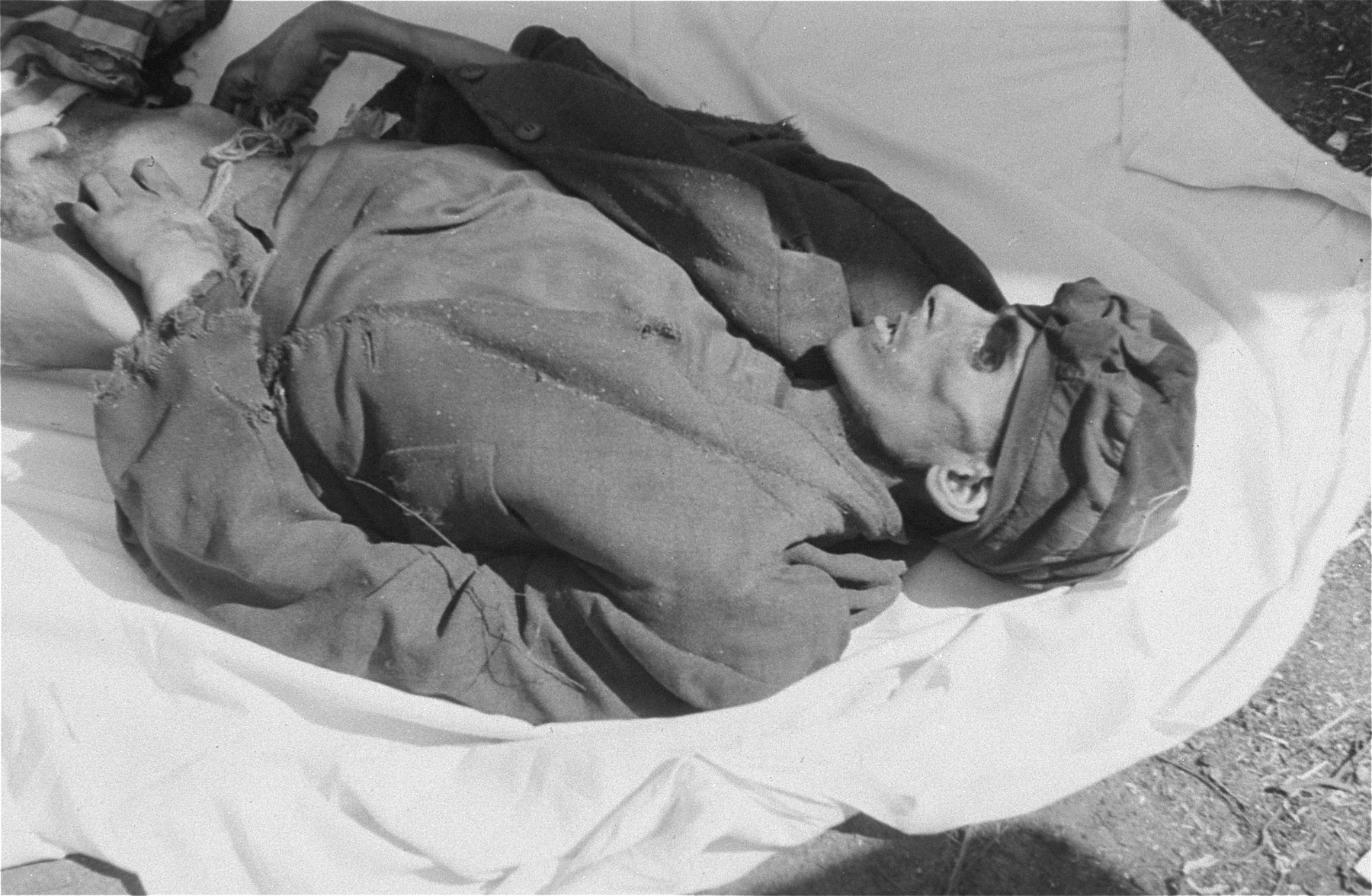 The corpse of a man in Woebbelin who died of starvation prior to the liberation of the camp.