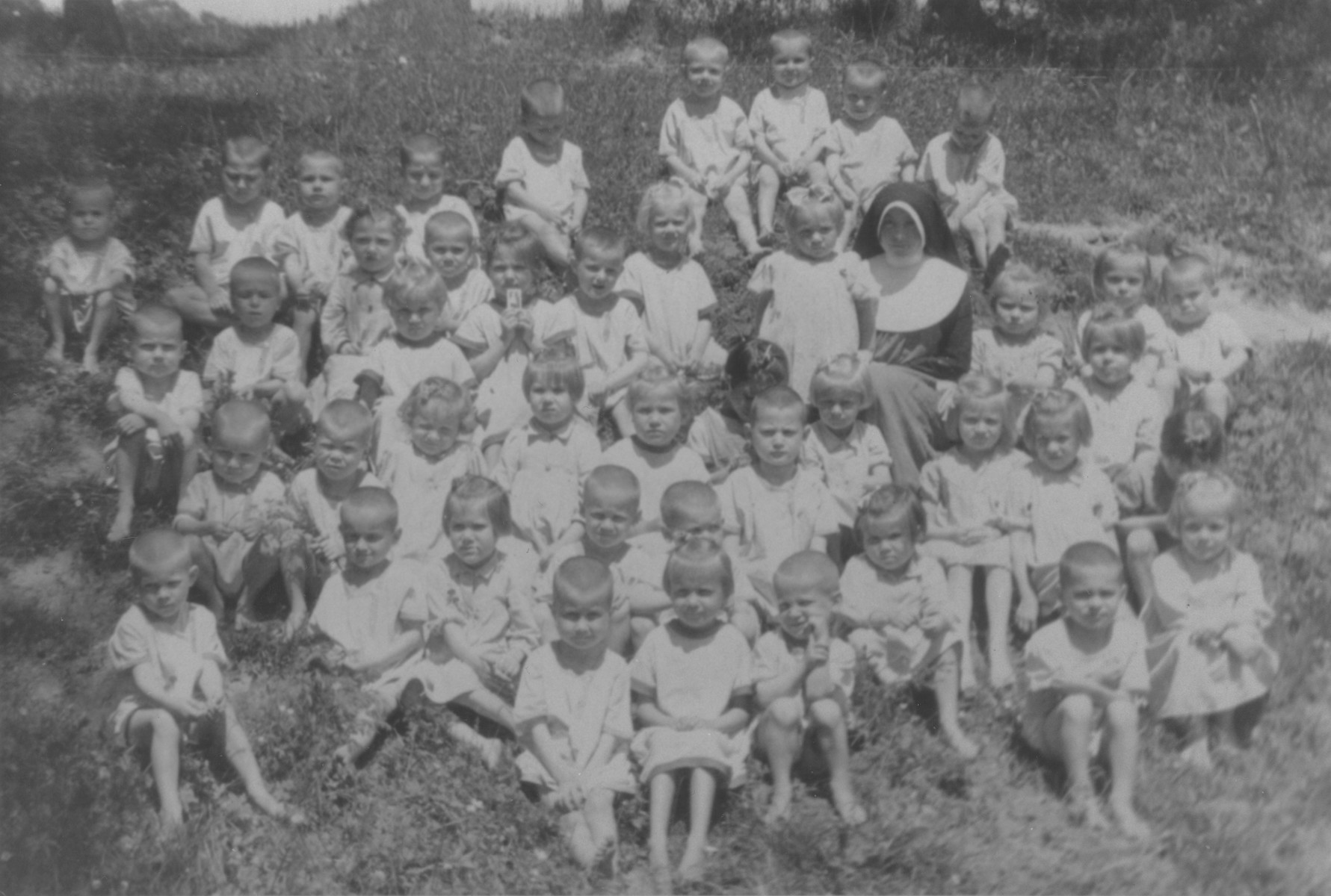 Sister Jadwiga poses with a group of small children at a convent school in Lomna, Poland that sheltered Jewish children during the German occupation.