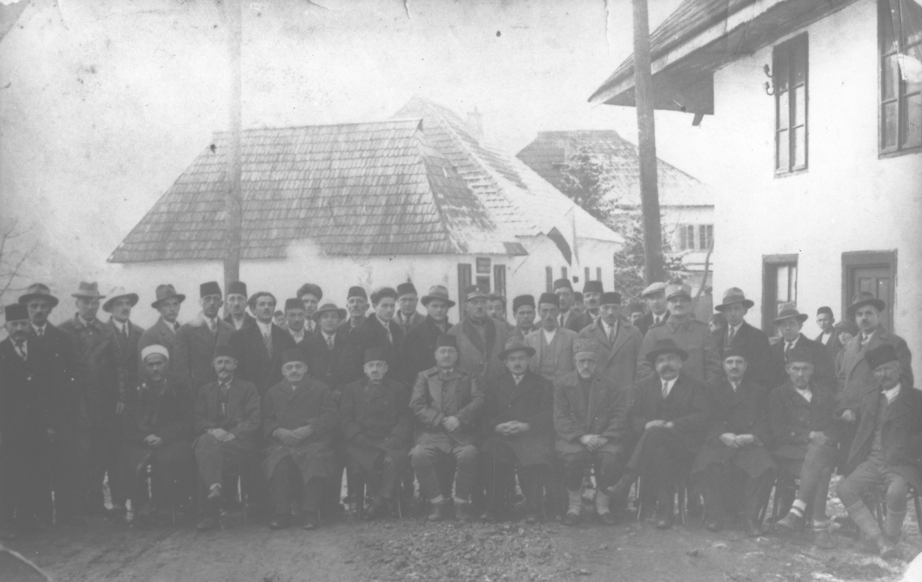 Group portrait of members of the Vlasenica town council.  Among those pictured are the Jewish brothers, Sumbul and Santo Altarac.