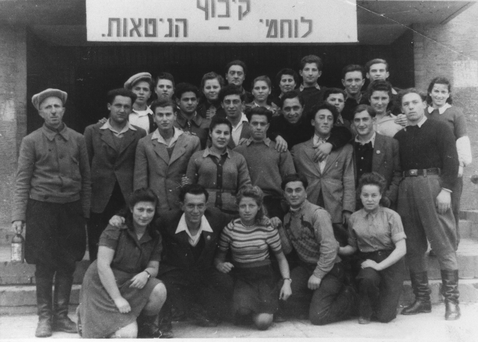 Group portrait of members of the Ghetto Fighters kibbutz hachshara [Zionist collective] at the Eschwege displaced persons camp.