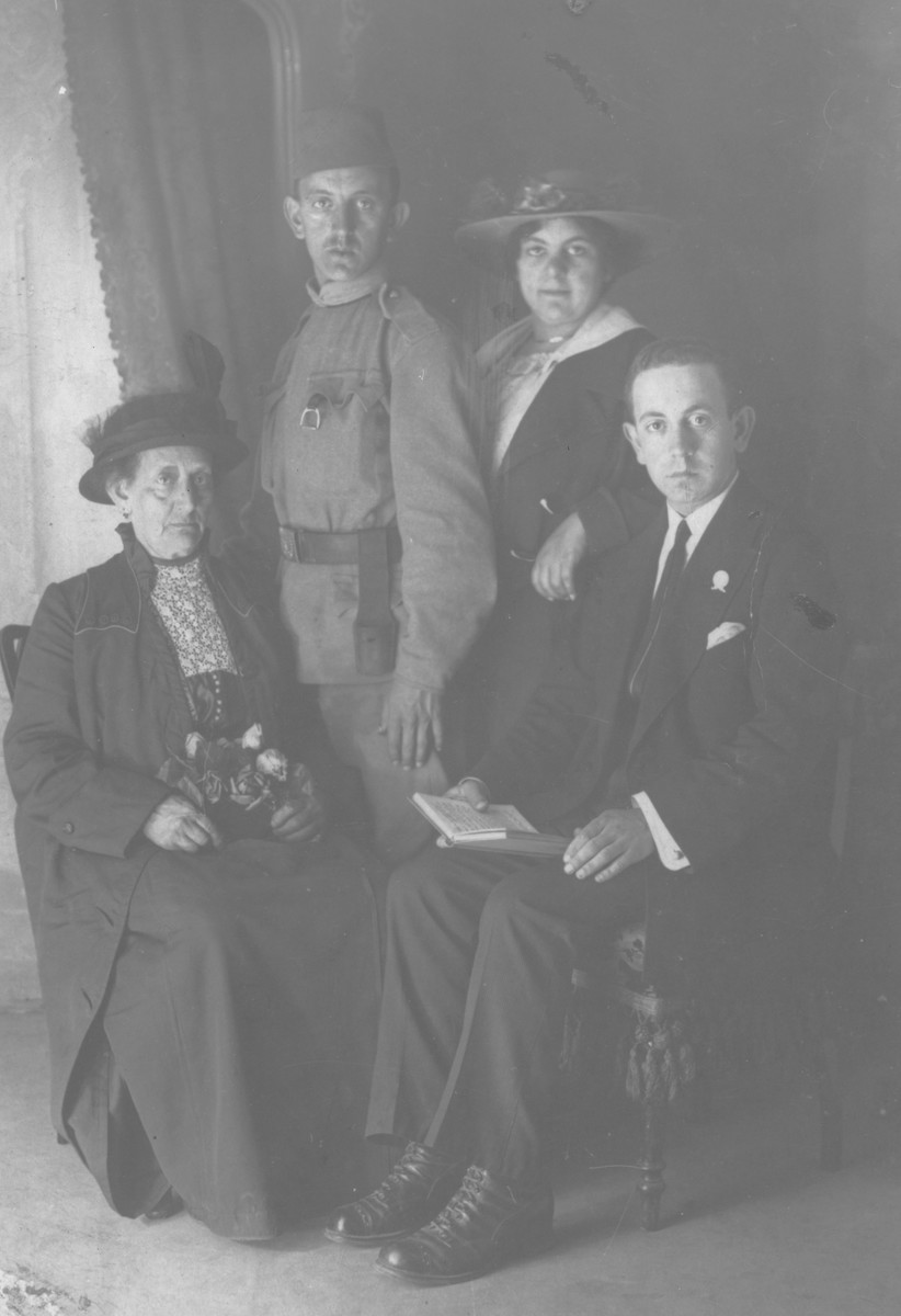 Studio portrait of a Jewish family in Sarajevo.  Pictured are Michael, Leon and Erdonja Kabilio with their mother.  All besides Michael perished during World War II in the Jasenovac concentration camp.