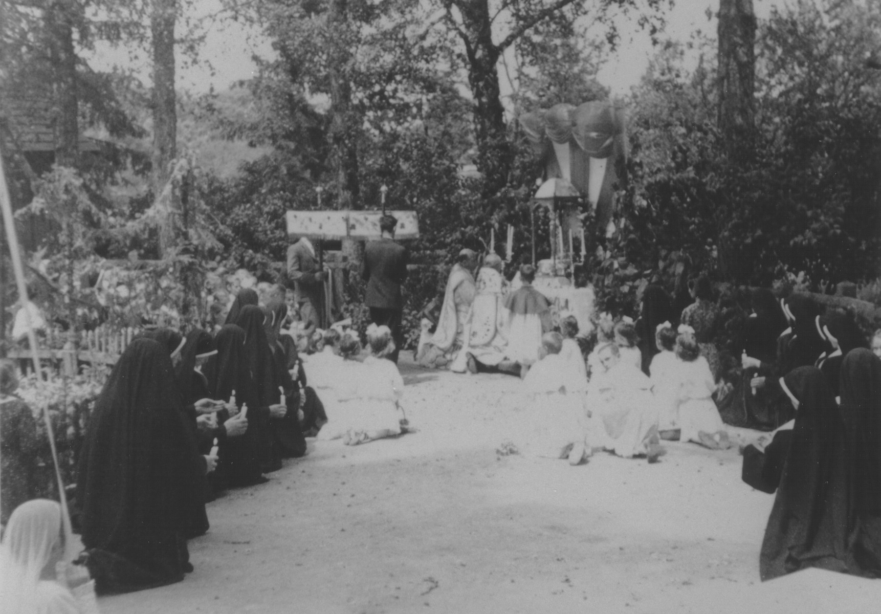 Priests conduct Easter mass for a group of nuns and children at a convent school in Lomna, Poland which sheltered Jewish children during the German occupation.