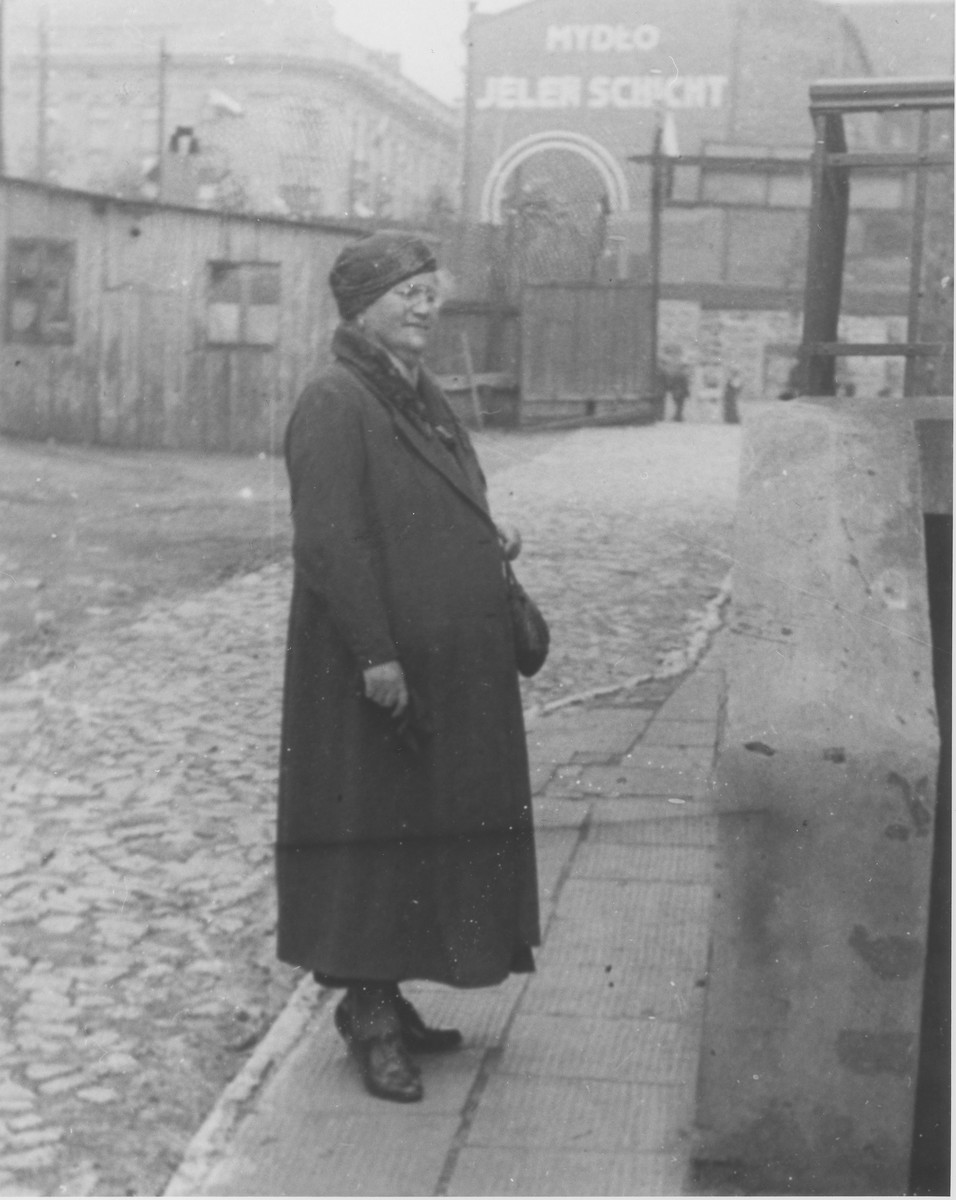 Maria Frajda Laudon poses near the entrance to a soap factory in Bedzin, Poland.