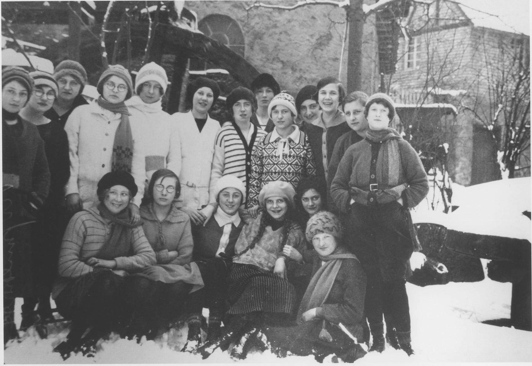 Group portrait of school girls on a winter outing.  Among those pictured is Hede Rueb (standing fourth from the right, behind two girls).