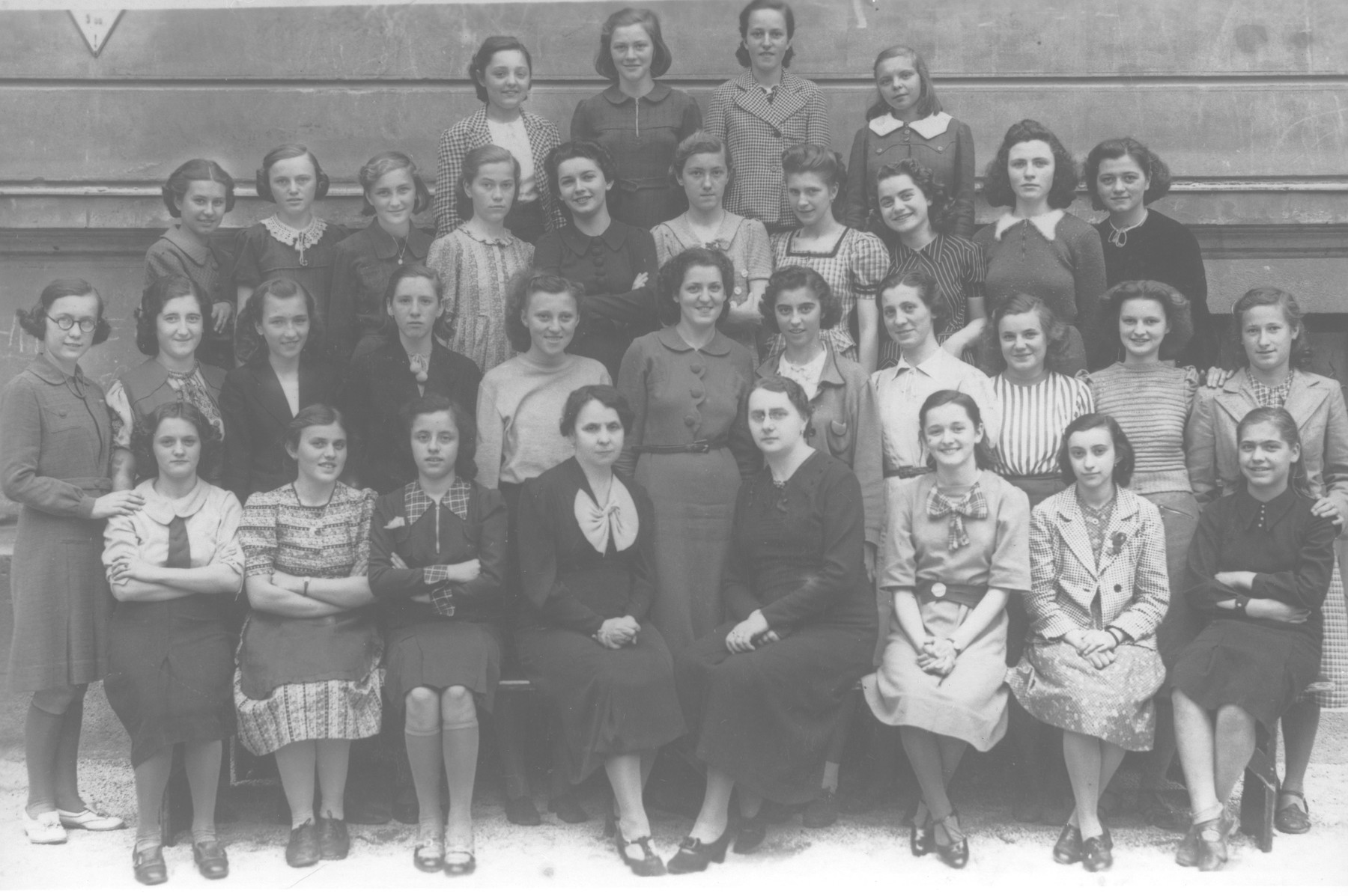 Class portrait of female students at a school in Zagreb attended by both Jews and non-Jews.  Among those pictured is Florica Kabilio (second row from the top at the far right).